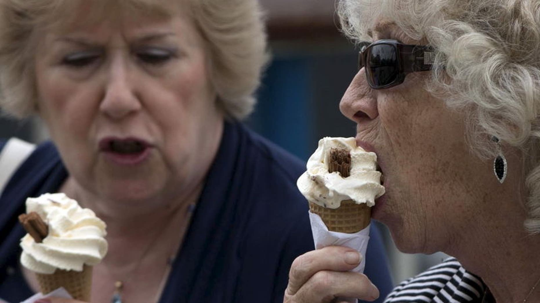 Women eat ice cream cones in London, Britain, in this photograph taken on August 29, 2015. REUTERS/Neil Hall