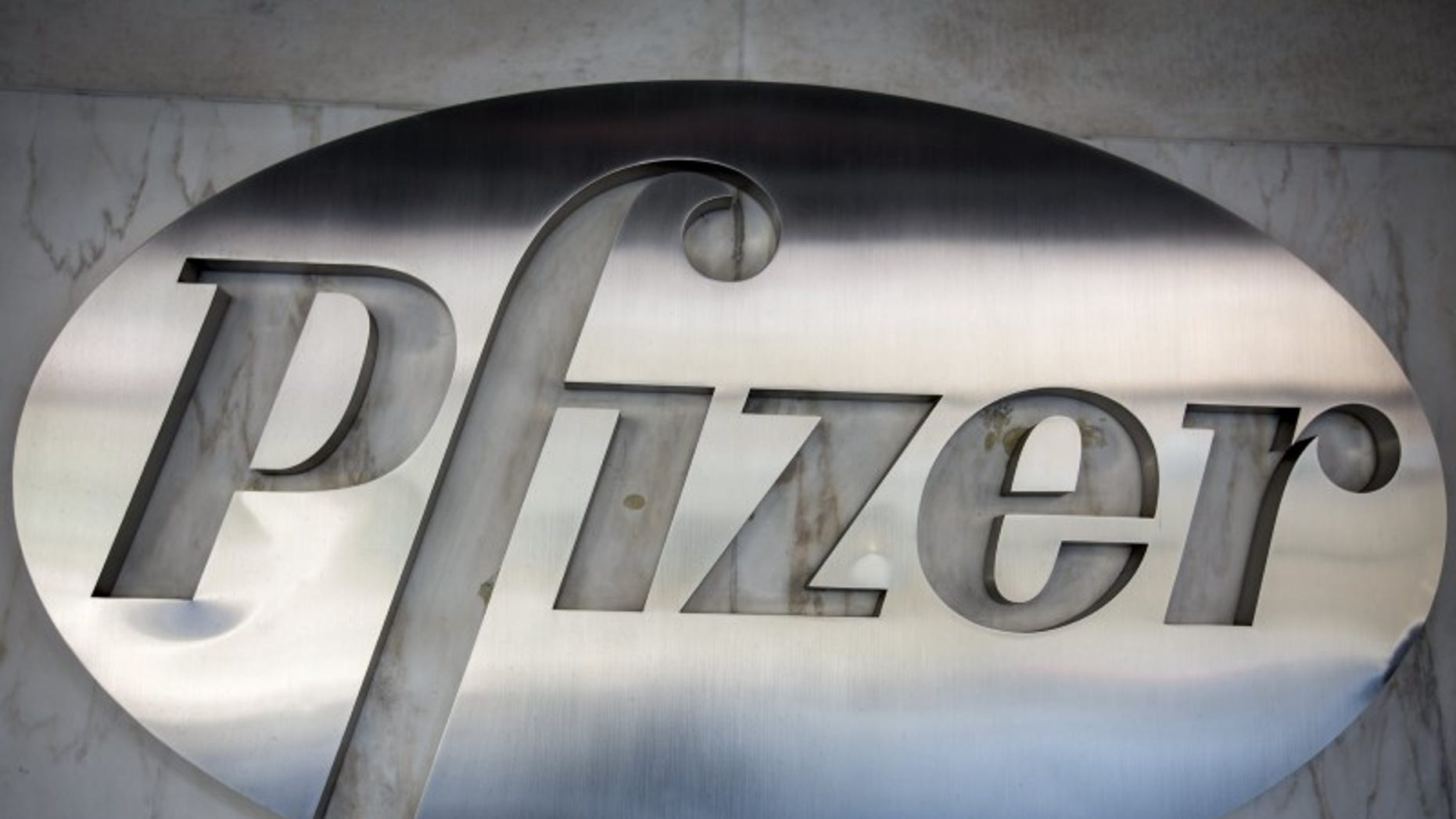 The Pfizer logo is pictured at their building in the Manhattan borough of New York October 29, 2015. REUTERS/Carlo Allegri