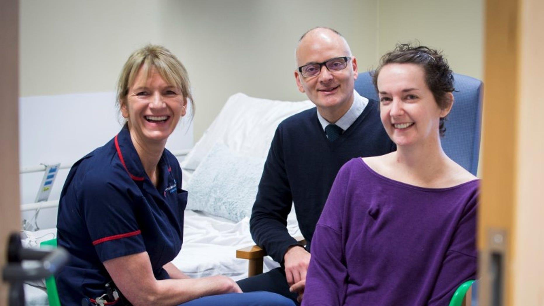 Pauline Cafferkey (R) smiles alongside Doctor Michael Jacobs and Senior Matron Breda Athan at the Royal Free Hospital in London, November 11, 2015. REUTERS/Royal Free Hospital/Handout