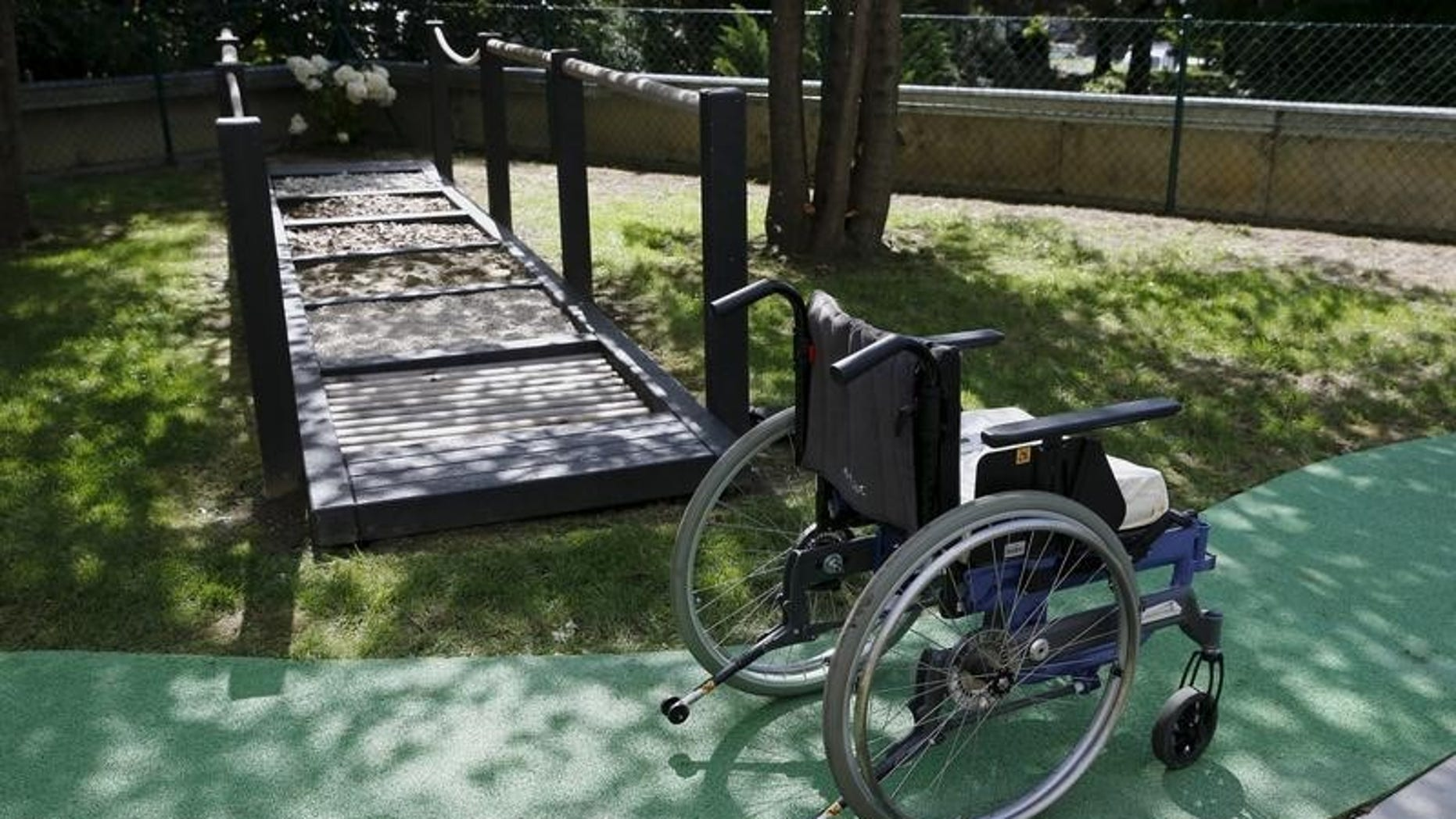 A wheelchair is pictured next to a walking frame during a media presentation in the 300-square-metre therapeutic garden of the Acute Neurological Rehabilitation Unit at Lausanne University Hospital (CHUV) in Lausanne, Switzerland, August 25, 2015. REUTERS/Denis Balibouse