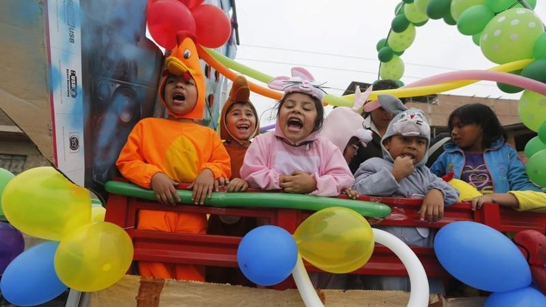 Preschool children dressed as animals participate in a parade ahead of preschool education celebration day, at the district of Villa El Salvador on the outskirts of Lima, May 23, 2014.  REUTERS/Mariana Bazo