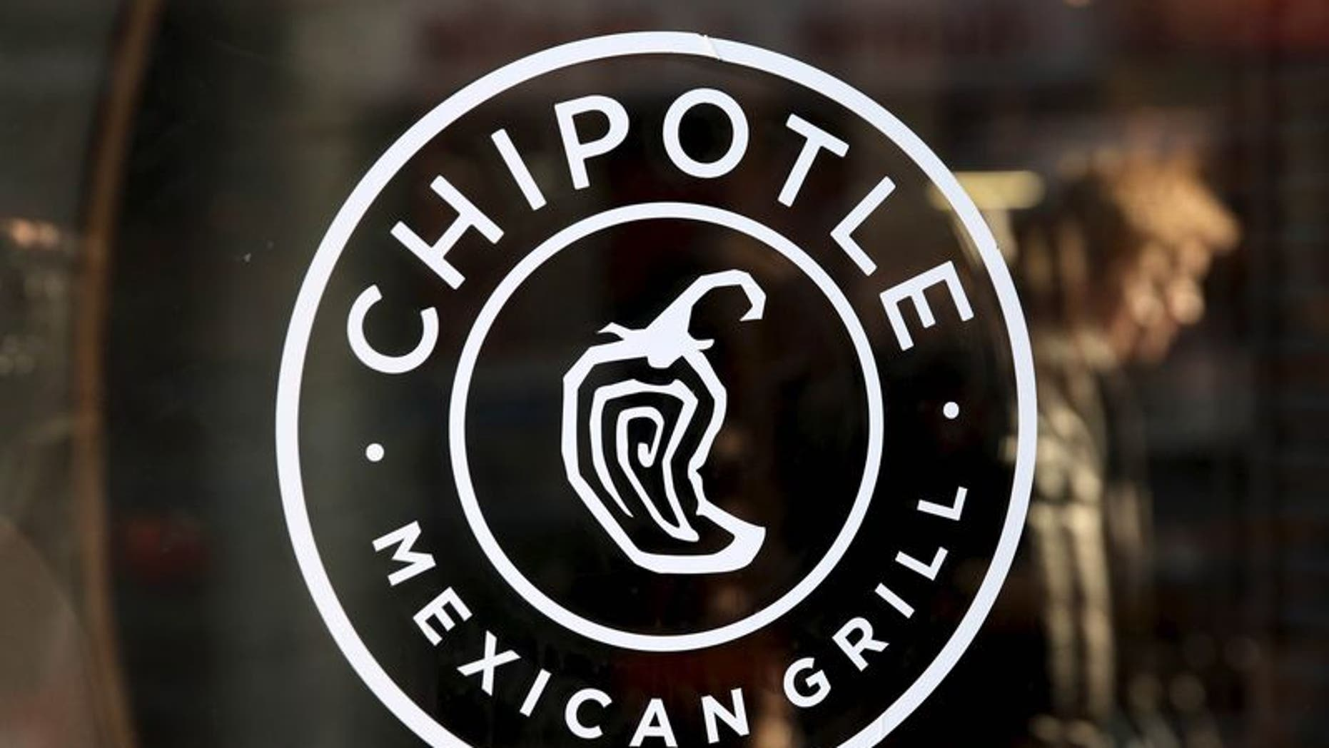A logo of Chipotle Mexican Grill is seen on a store entrance in Manhattan, New York in this November 23, 2015 file photo.  REUTERS/Andrew Kelly/Files