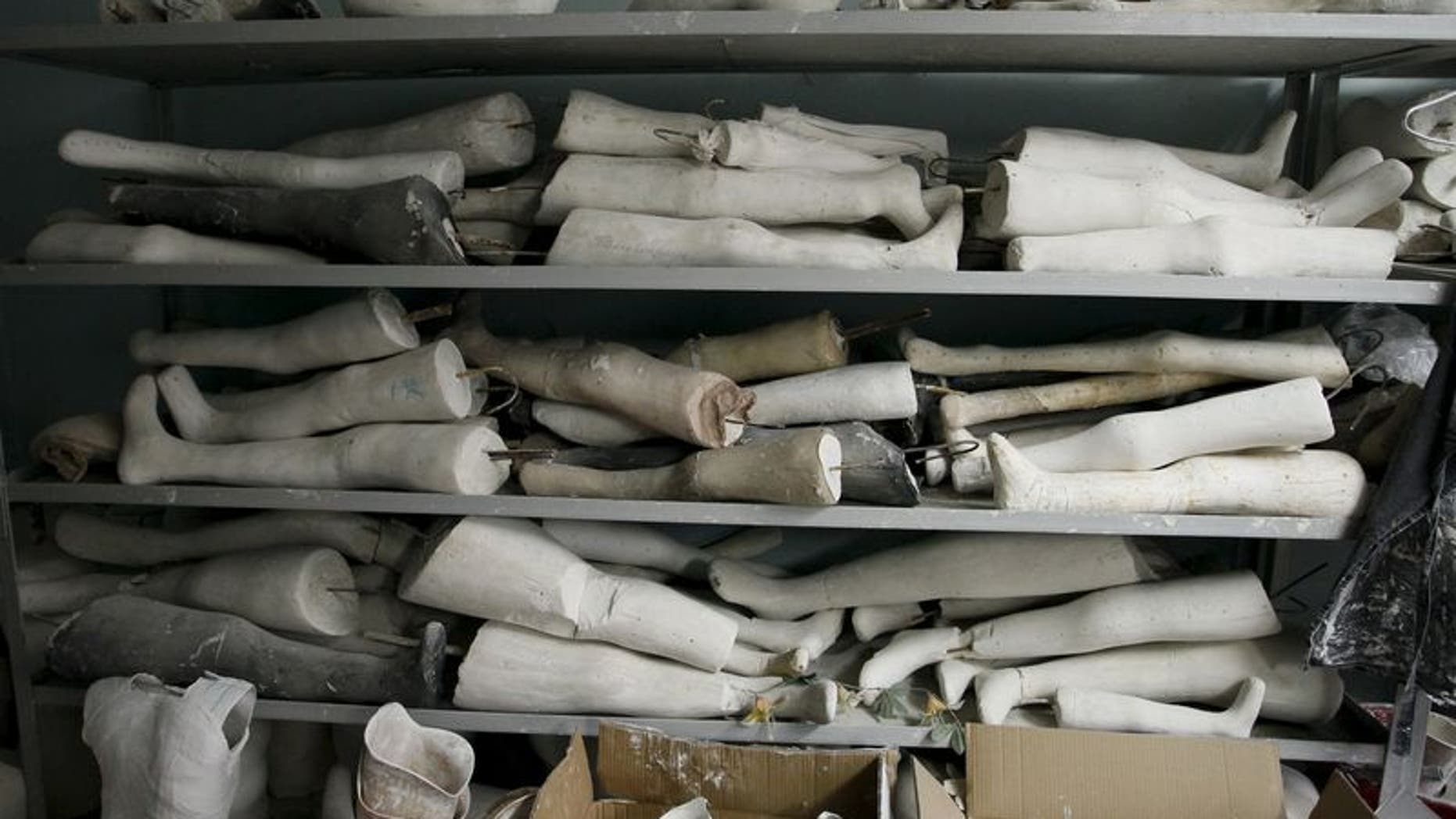 Plaster of Paris moulds of legs are stored at the Orthopedic Center in Donetsk, Ukraine, December 2, 2015.  REUTERS/Alexander Ermochenko