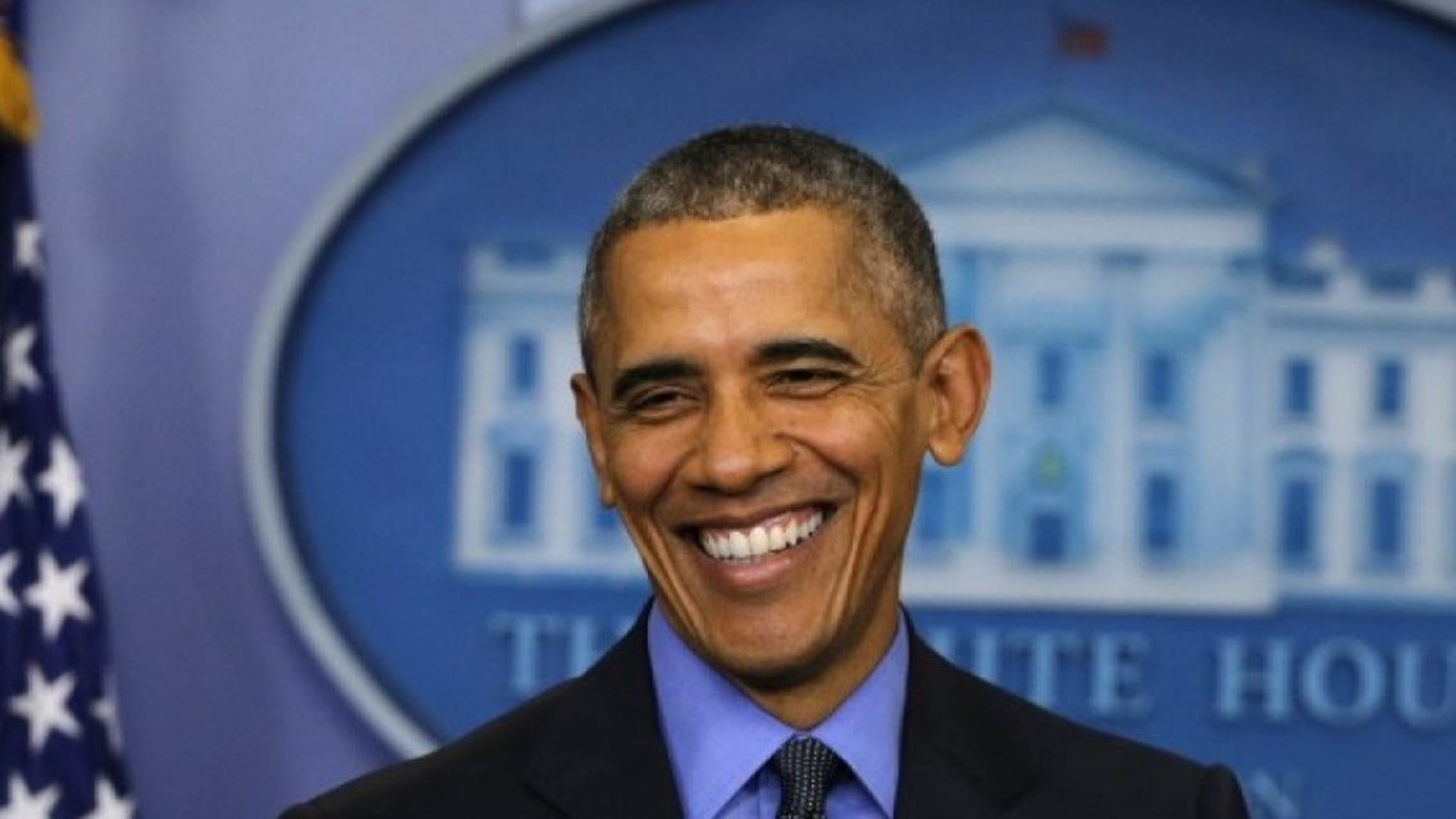 U.S. President Barack Obama smiles as he holds his end of the year news conference at the White House in Washington December 18, 2015. REUTERS/Carlos Barria