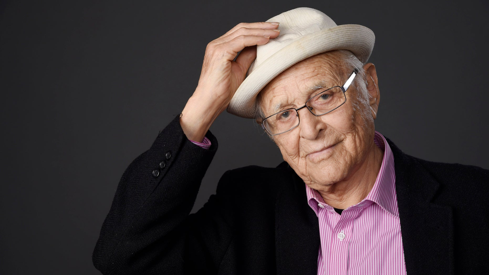 """Television writer and producer Norman Lear, the subject of an """"American Masters"""" documentary that will air on PBS in 2016, poses for a portrait during the 2015 Television Critics Association Summer Press Tour at the Beverly Hilton on Saturday, Aug. 1, 2015, in Beverly Hills, Calif. (Photo by Chris Pizzello/Invision/AP)"""