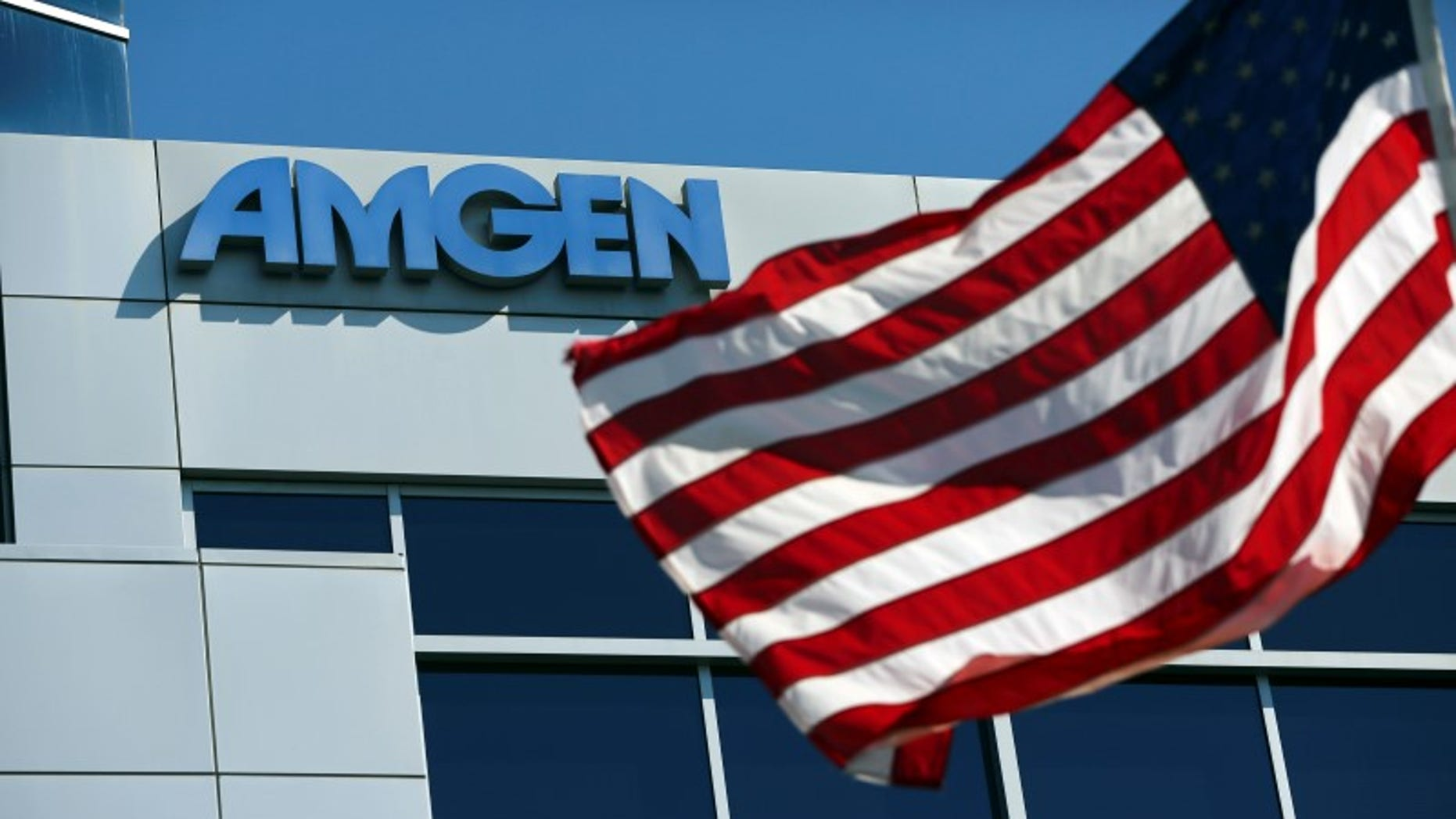 An Amgen sign is seen at the company's office in South San Francisco, California October 21, 2013. REUTERS/Robert Galbraith  (UNITED STATES