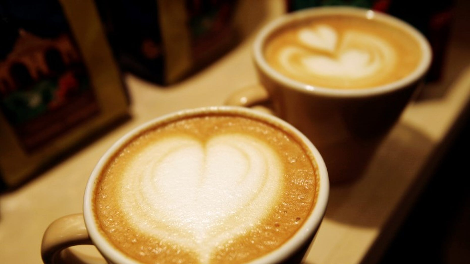 Cups of cappuccino sit on a table during the World Coffee Conference in Guatemala City