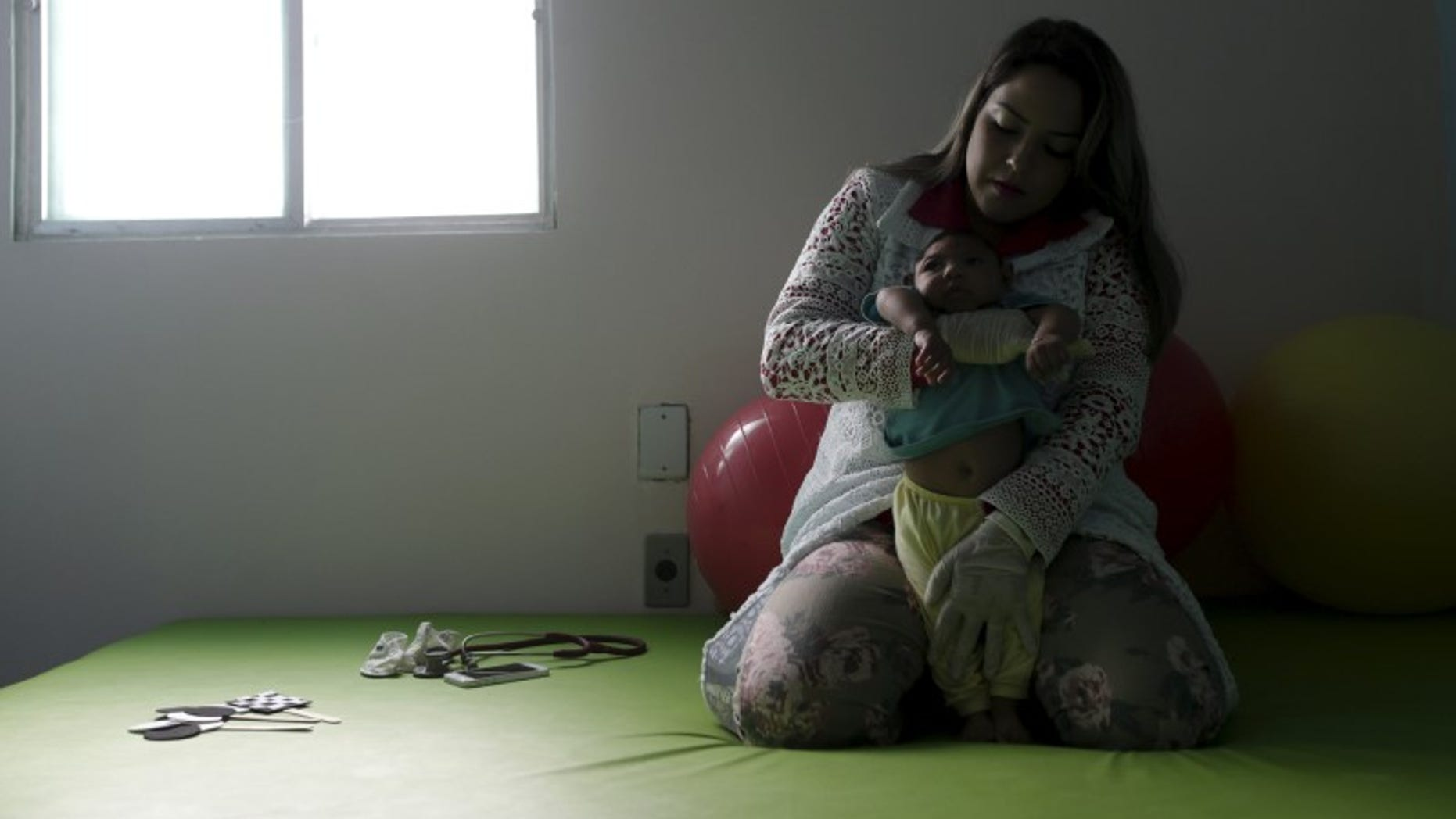 Physiotherapist Leal does exercises with Lucas, 4-months old, who is Miriam Araujo's second child and born with microcephaly in Pedro I hospital in Campina Grande
