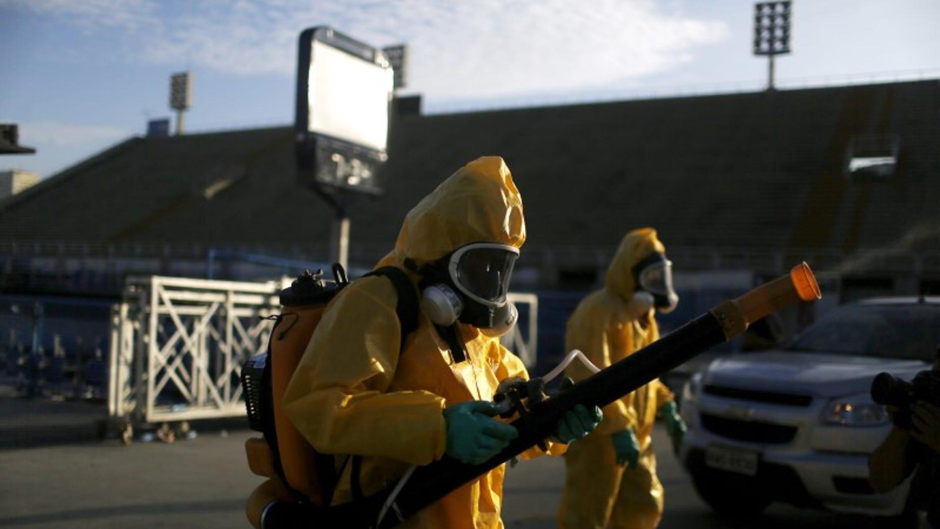 Municipal workers spray insecticide at Sambodrome in Rio de Janeiro