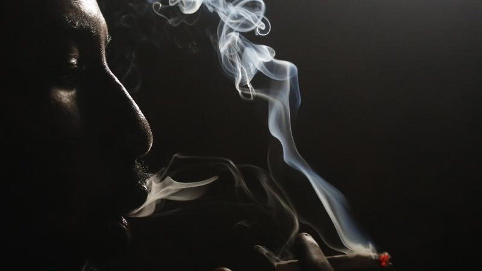 A heroin addict smokes heroin in Lamu