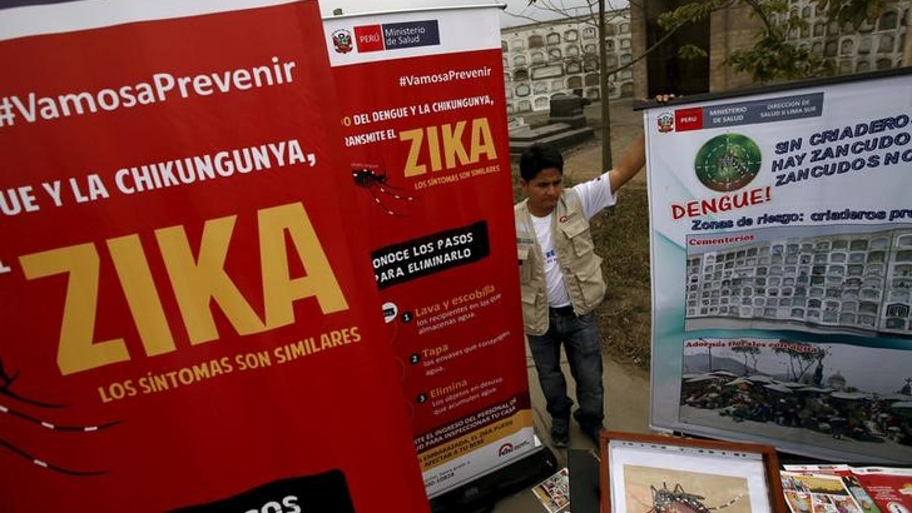 A health worker gives information during a preventive campaign against the Zika virus and other mosquito-borne diseases, at the cemetery of Presbitero Maestro in Lima