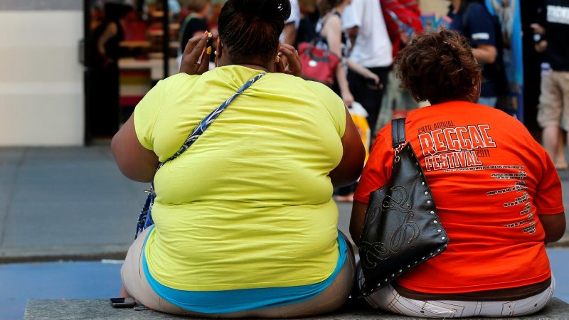 Women sit on bench in New York