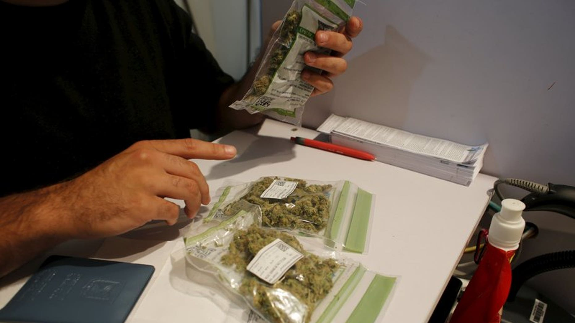 Packages of medical marijuana are seen on a counter at a dispensary belonging to Tikun Olam, Israel's largest medical marijuana supplier, in Tel Aviv