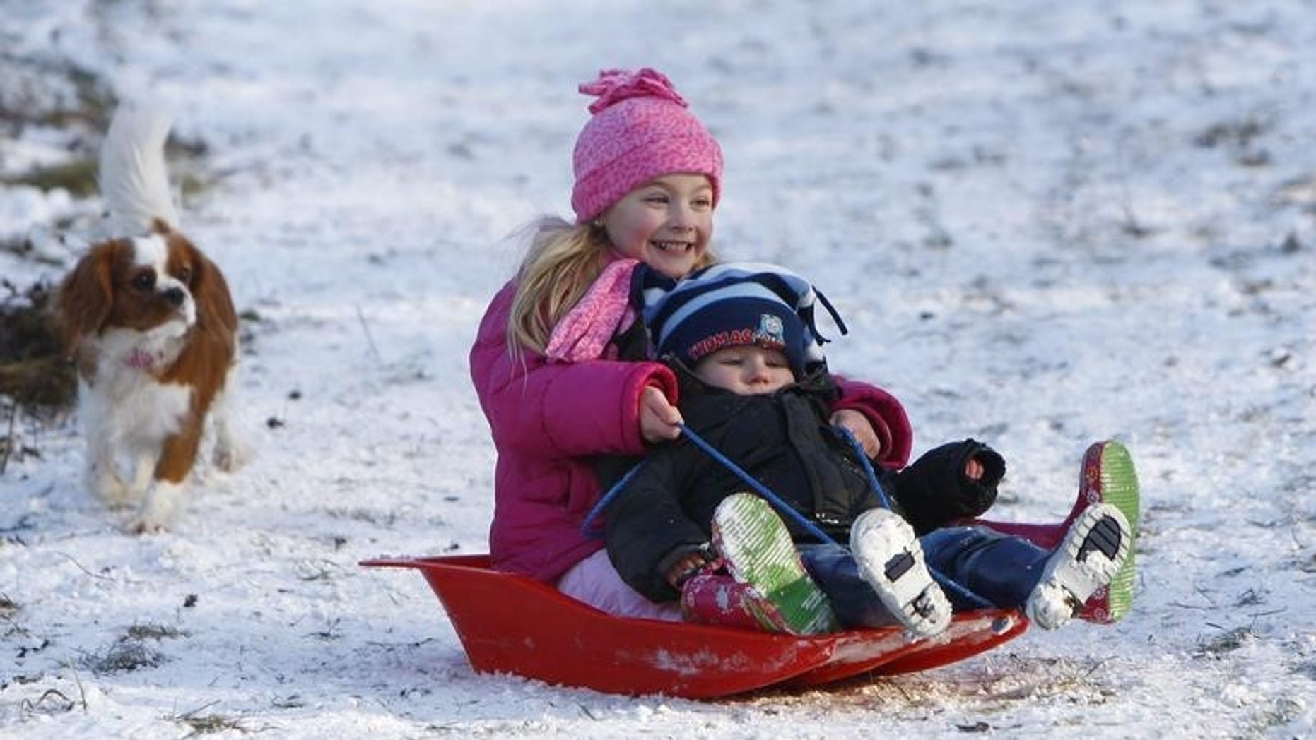 Youngsters toboggan in Princes Risborough, southern England