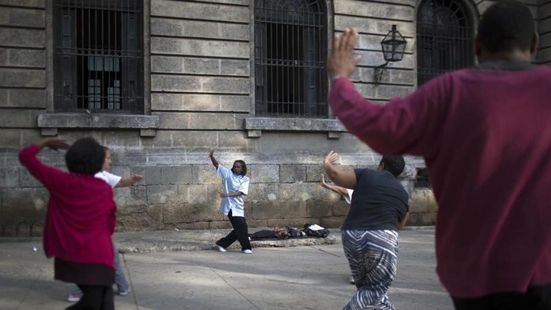 People practise Tai Chi in Havana