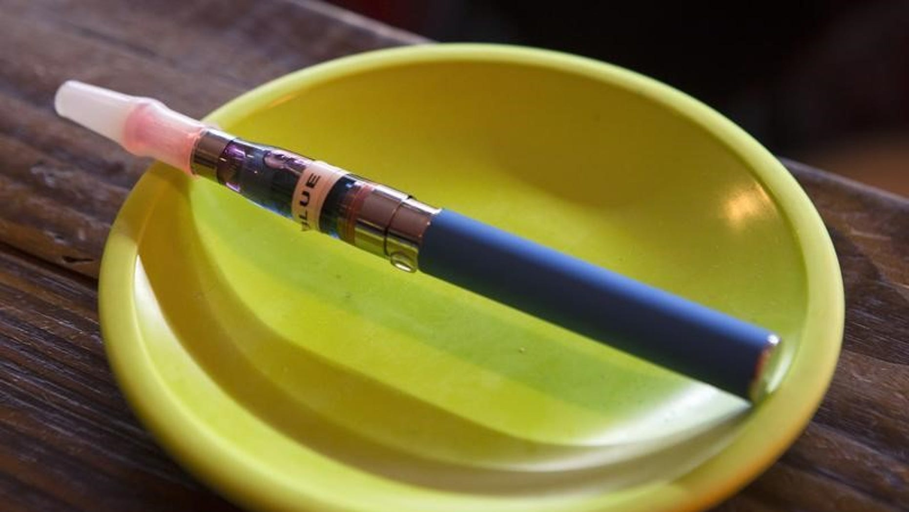 An e-cigarette sits in a tray on the bar at the Henley Vaporium in New York City