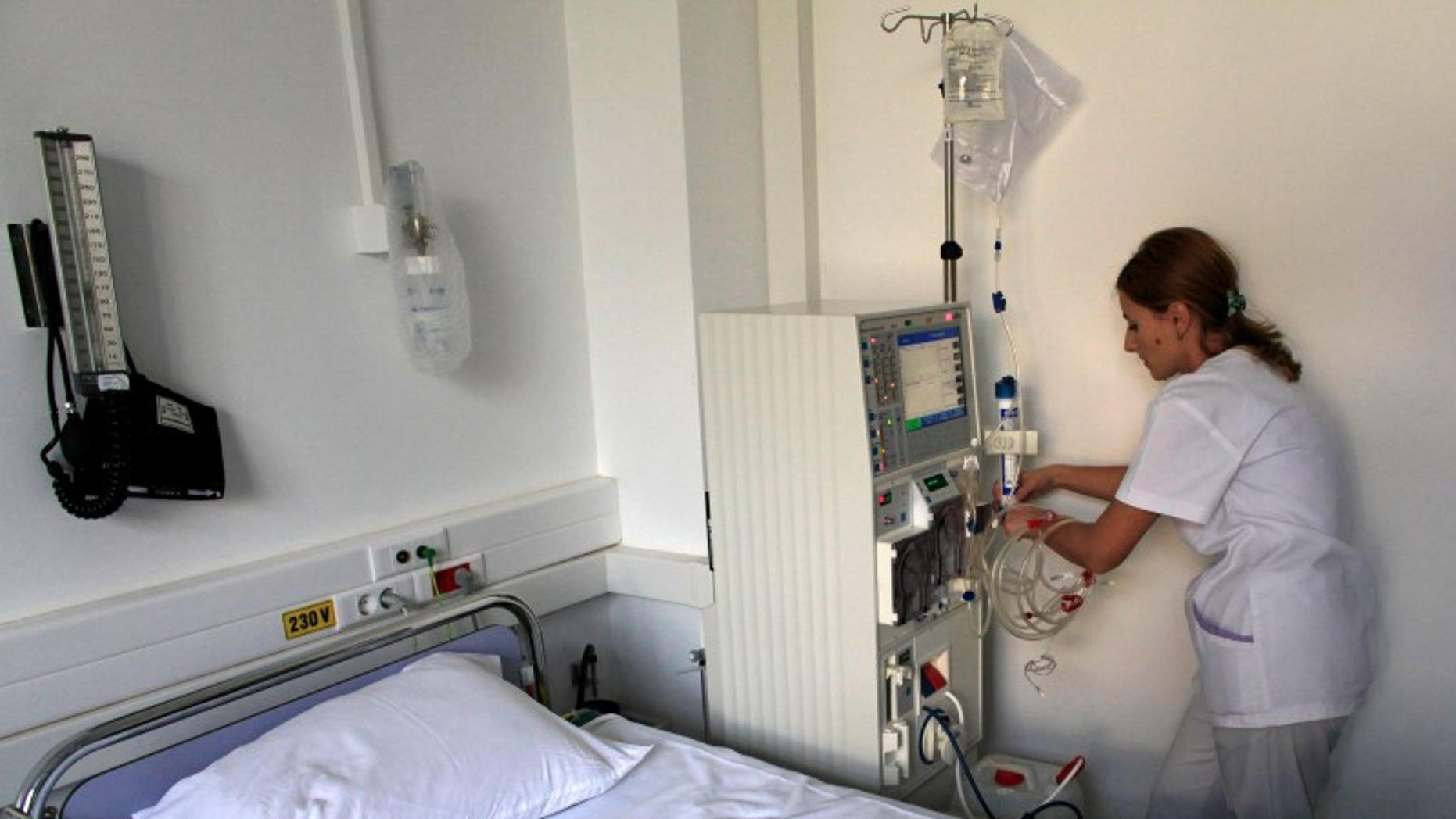 Nurse Georgiana Stefan prepares a dialysis machine for a diabetes patient at Nicolae Paulescu National Institute for Diabetes, Nutrition and Metabolic Diseases in Bucharest