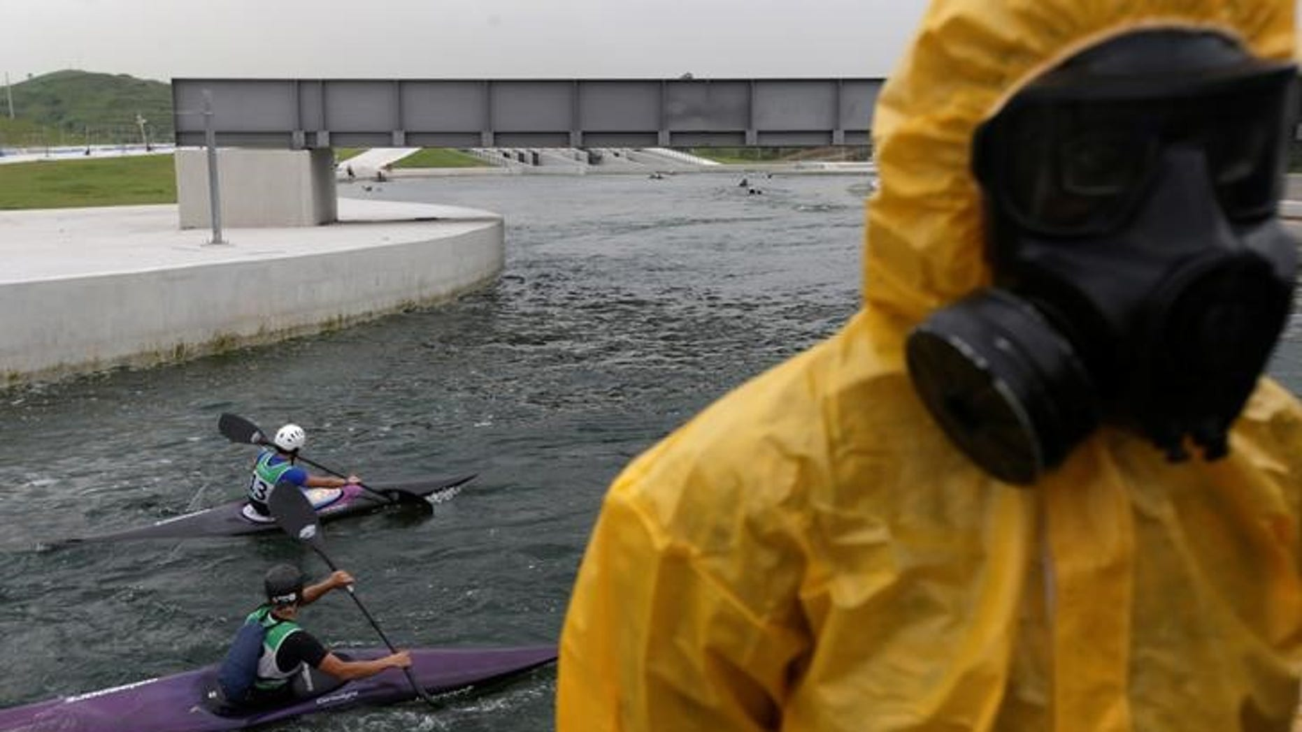 Athletes attend a training session at 2016 Rio Olympics Games' Canoe Slalom Circuit as Brazilian Army soldiers take part in a simulation of decontamination of multiple victims during a a training in Rio de Janeiro