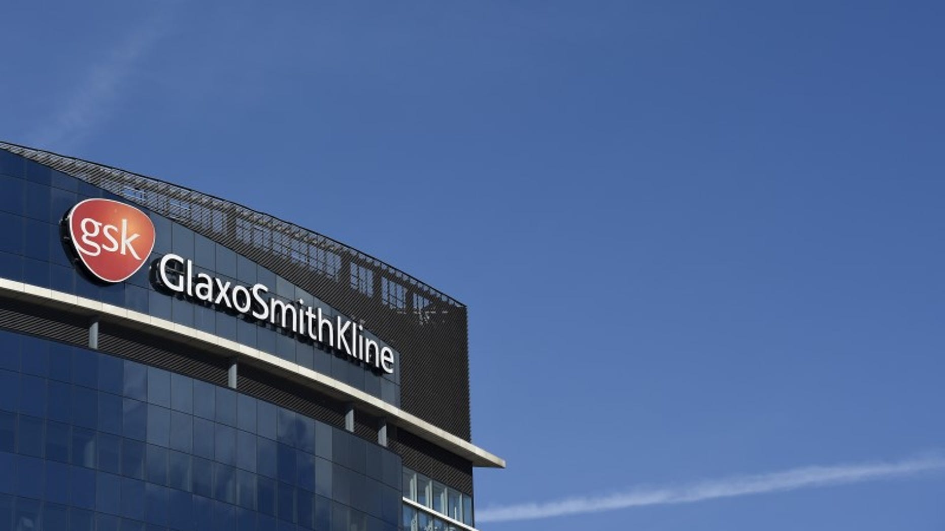 Signage for GlaxoSmithKline is seen on it's offices in London, Britain