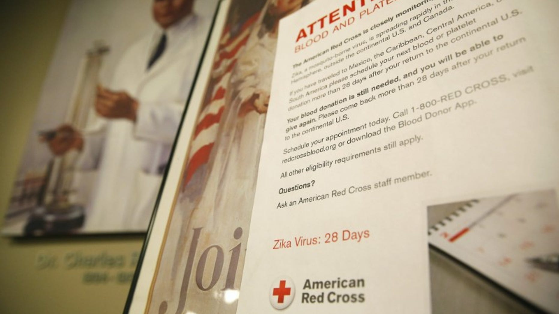 Sign explaining the parameters concerning the Zika virus and blood donations is seen at the American Red Cross Charles Drew Donation Center in Washington