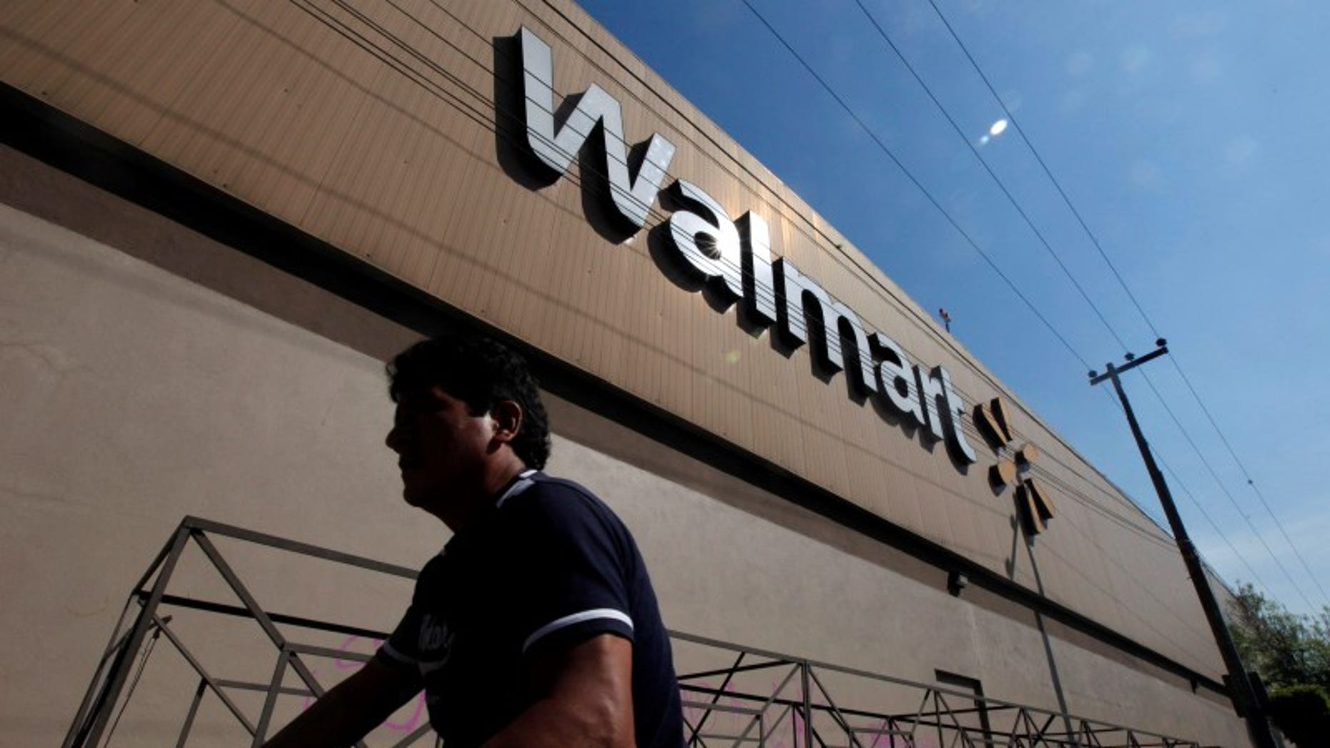 A person walks outside a Wal-Mart store in Mexico City