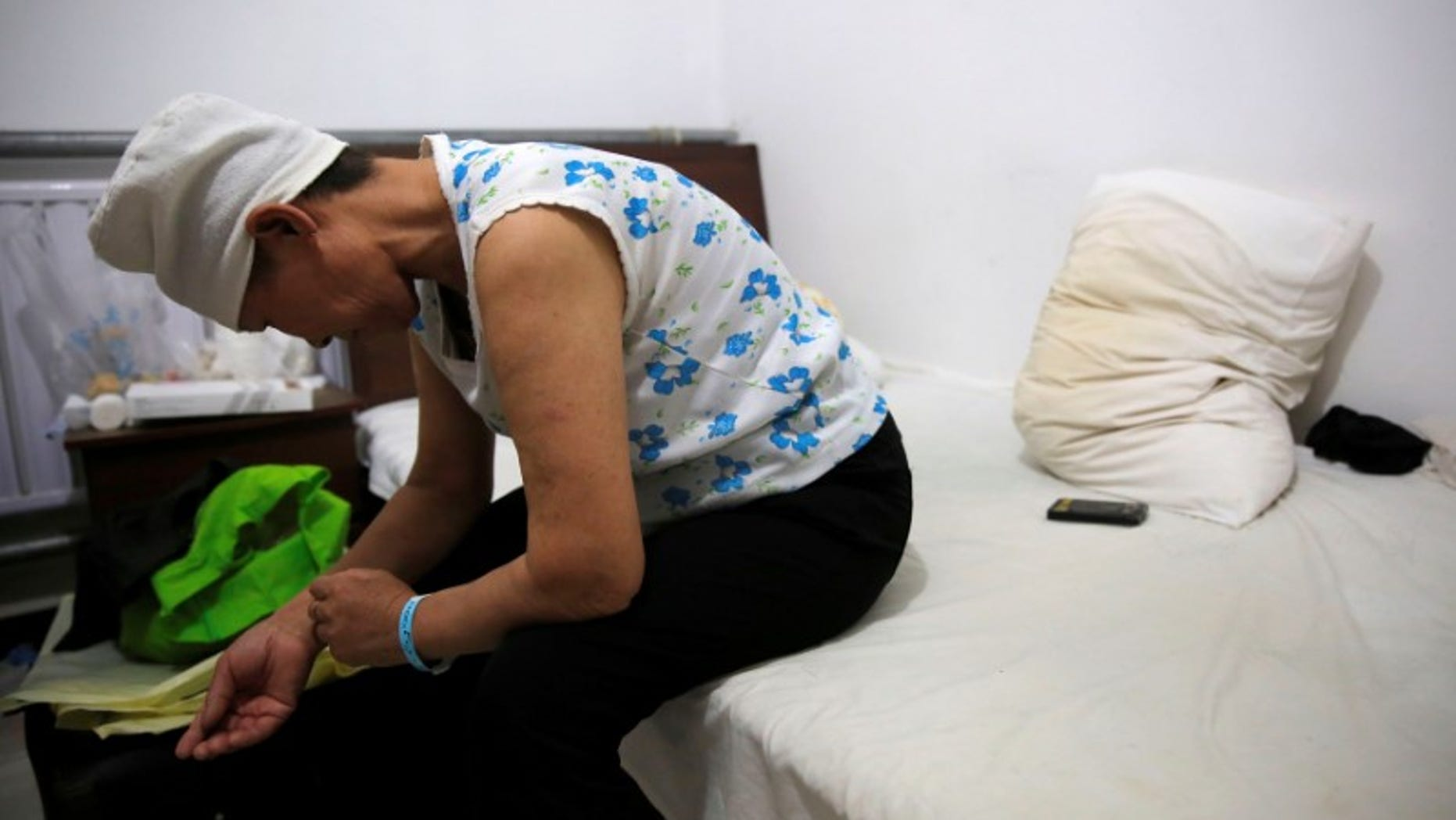 The Wider Image: China's cancer patients far from home