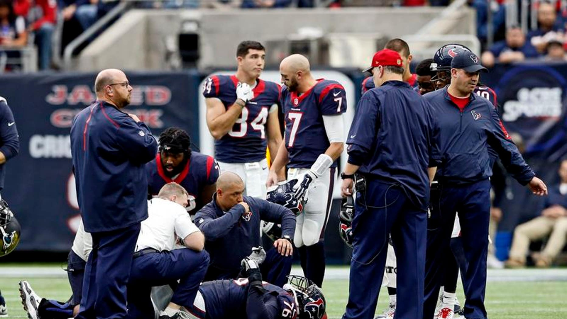 Houston Texans tackle Duane Brown is examined by team medical staff after being injured during the first half against the Jacksonville Jaguars at NRG Stadium in Houston, Texas