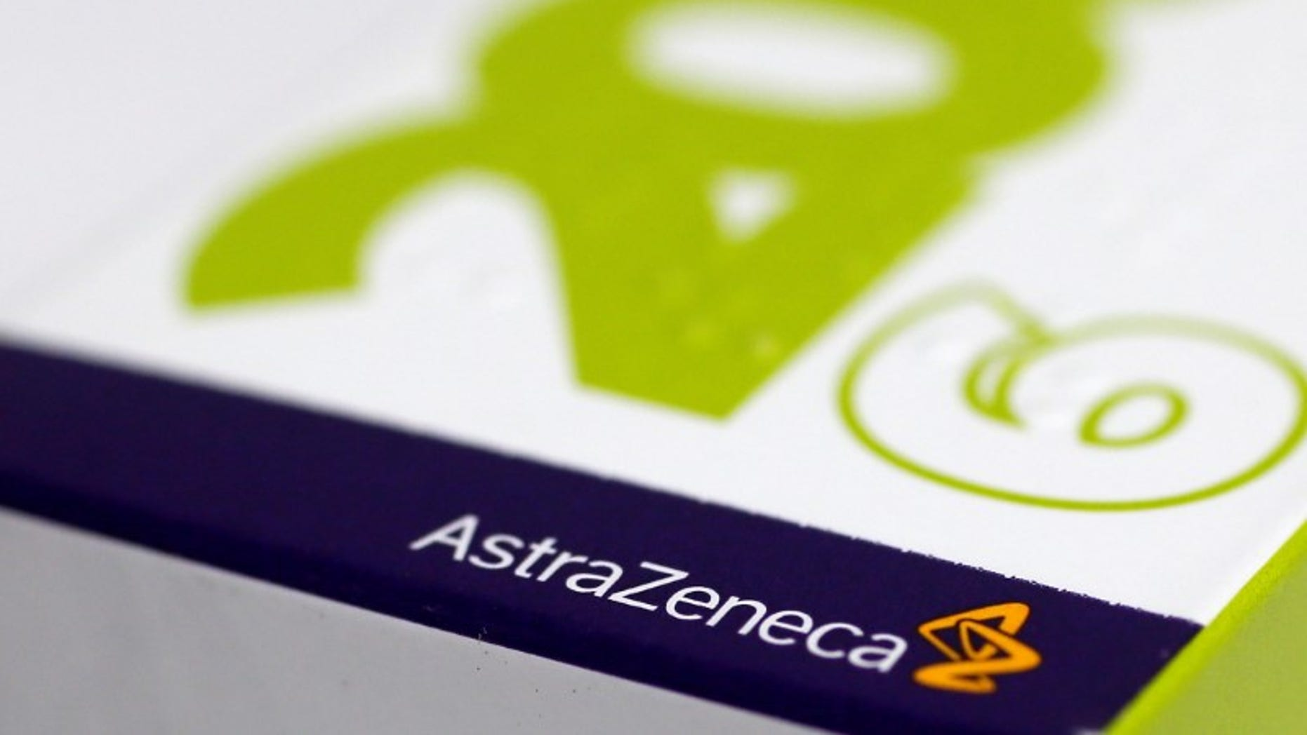 FILE PHOTO: The logo of AstraZeneca is seen on a medication package at a pharmacy in London