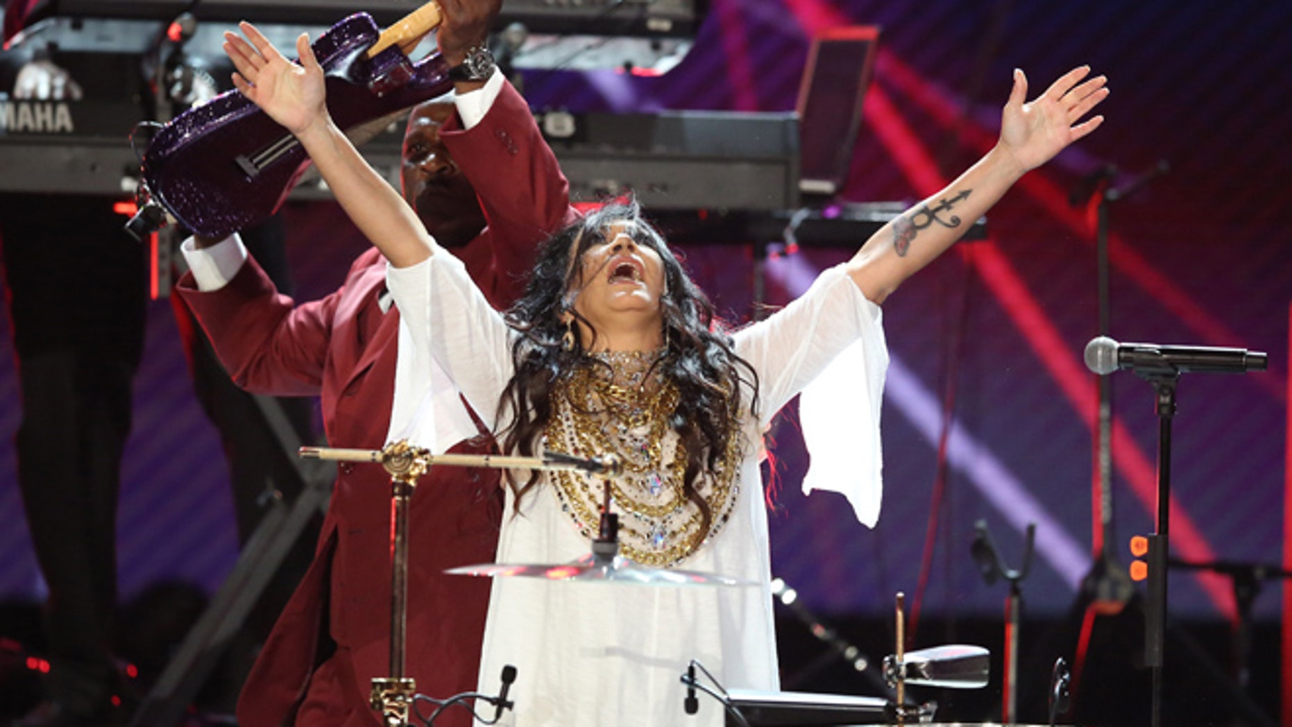 Sheila E. performs a tribute to Prince at the BET Awards at the Microsoft Theater on Sunday, June 26, 2016, in Los Angeles. (Photo by Matt Sayles/Invision/AP)