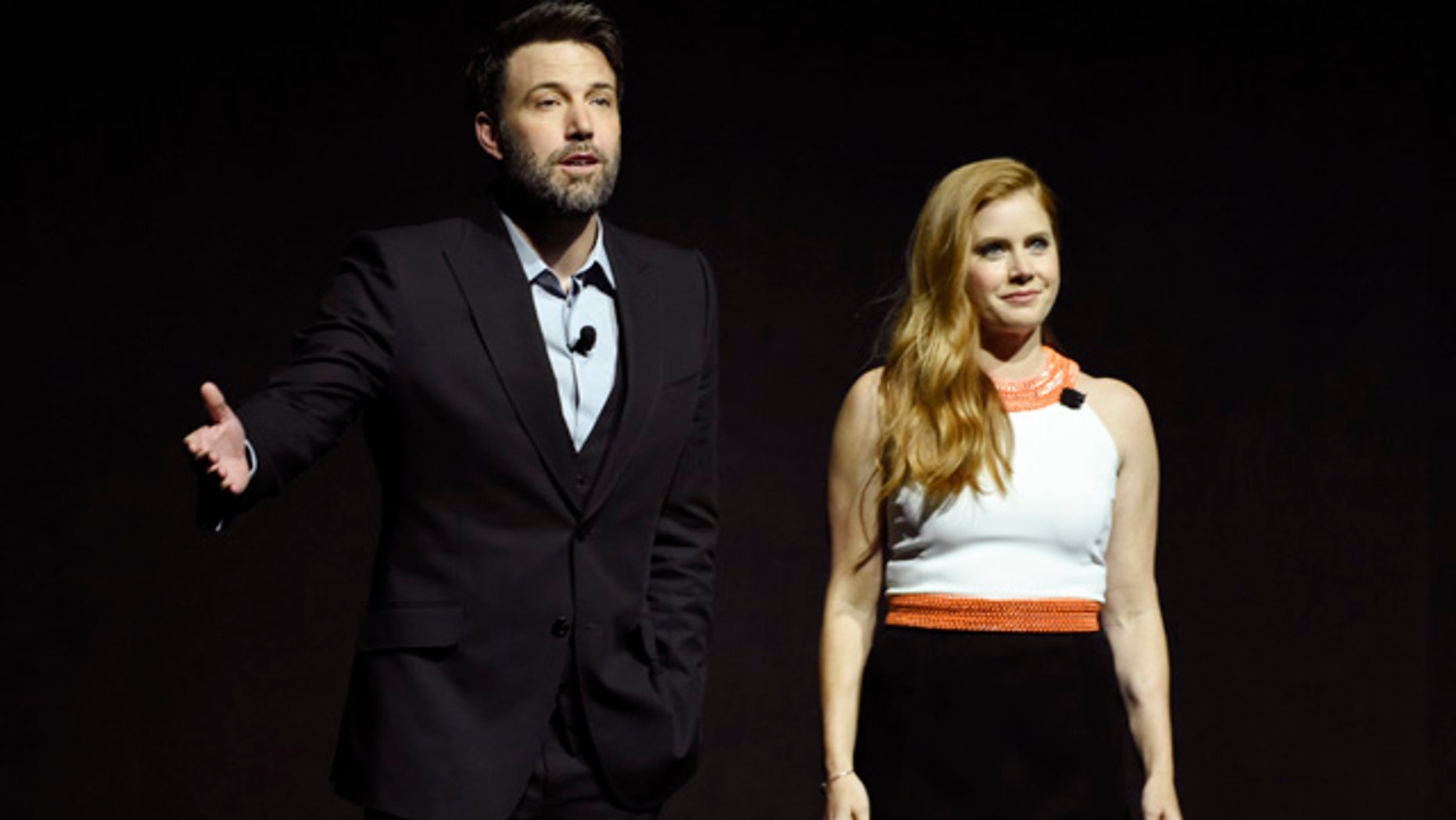 April 12, 2016: Ben Affleck and Amy Adams, cast members in the film 'Batman v Superman: Dawn of Justice,' address the audience during the Warner Bros. presentation at CinemaCon 2016, the official convention of the National Association of Theatre Owners (NATO), at Caesars Palace in Las Vegas. (Photo by Chris Pizzello/Invision/AP)