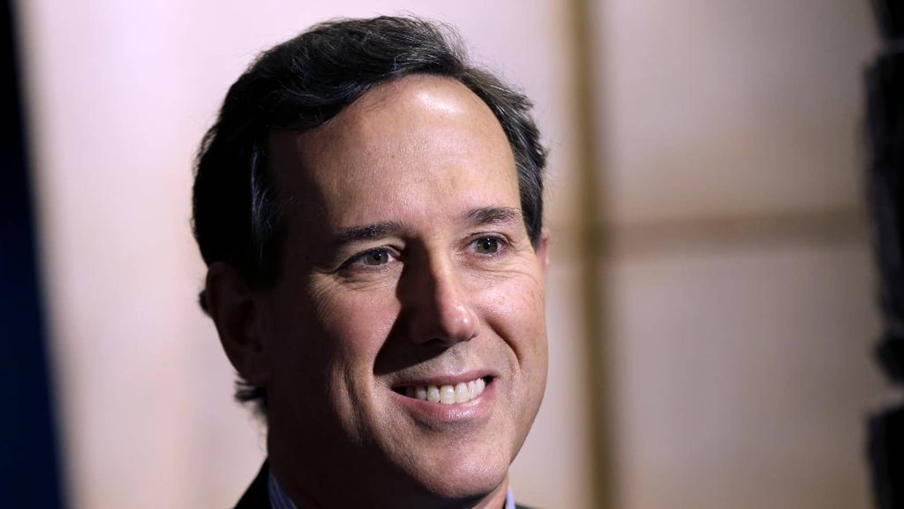 FILE - In this Nov. 18, 2013, file photo, former Pennsylvania Sen. Rick Santorum is seen in New York. Getting ready to run for president means working through a hefty checklist of activities long before most people are paying attention to the contest ahead. Prep work, positioning and auditioning don't wait for the primary season. Just about everyone thinking about running for president is kicking it into gear now, slowpokes included.  (AP Photo/Seth Wenig, File)