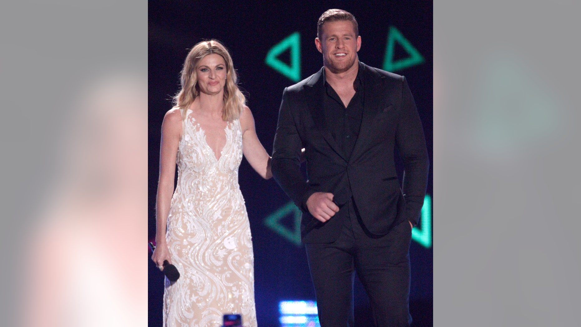 Host Erin Andrews, left,  and J.J. Watt appear on stage at the CMT Music Awards at the Bridgestone Arena on Wednesday, June 8, 2016, in Nashville, Tenn. (Photo by Wade Payne/Invision/AP)