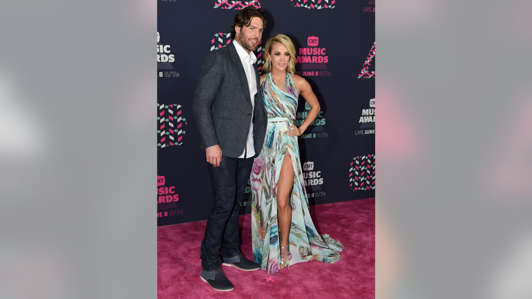 Mike Fisher, left, and Carrie Underwood arrive at the CMT Music Awards at the Bridgestone Arena on Wednesday, June 8, 2016, in Nashville, Tenn. (Photo by Sanford Myers/Invision/AP)