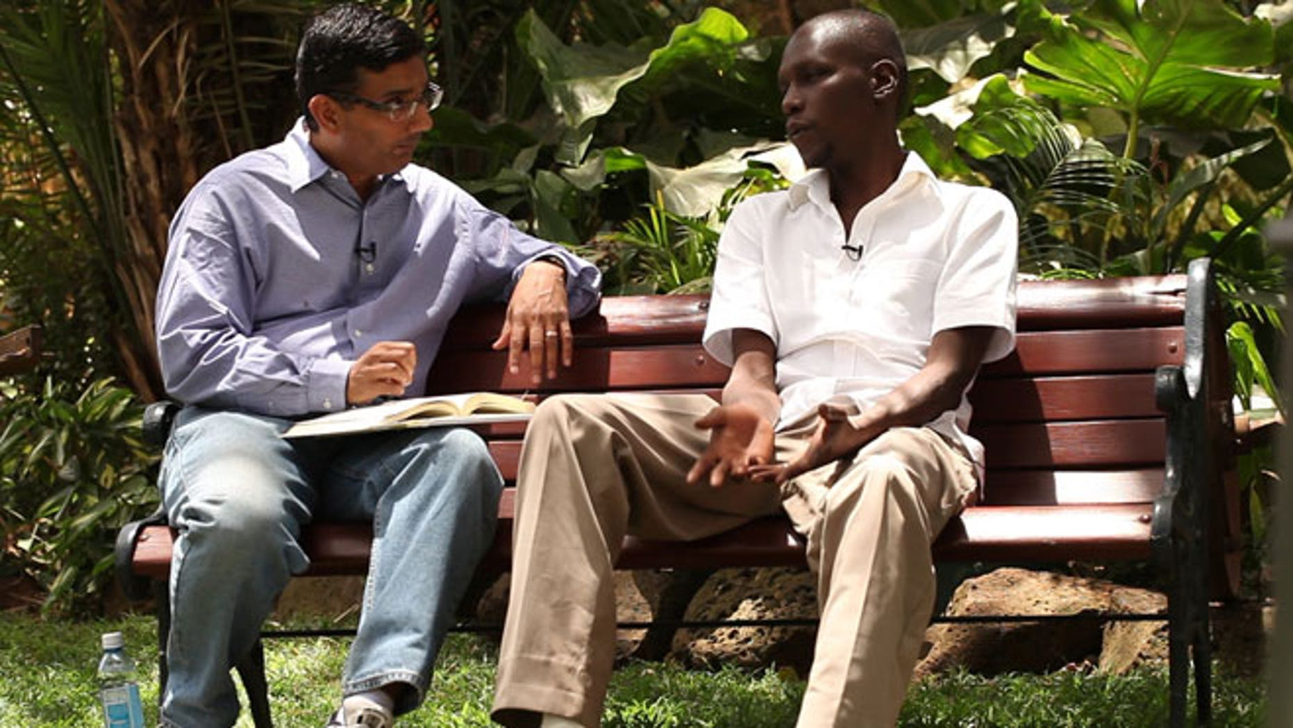 """This publicity image released by Rocky Mountain Pictures, shows an undated film clip of director, Dinesh D'Souza, interviewing George Obama in """"2016: Obama's America."""""""