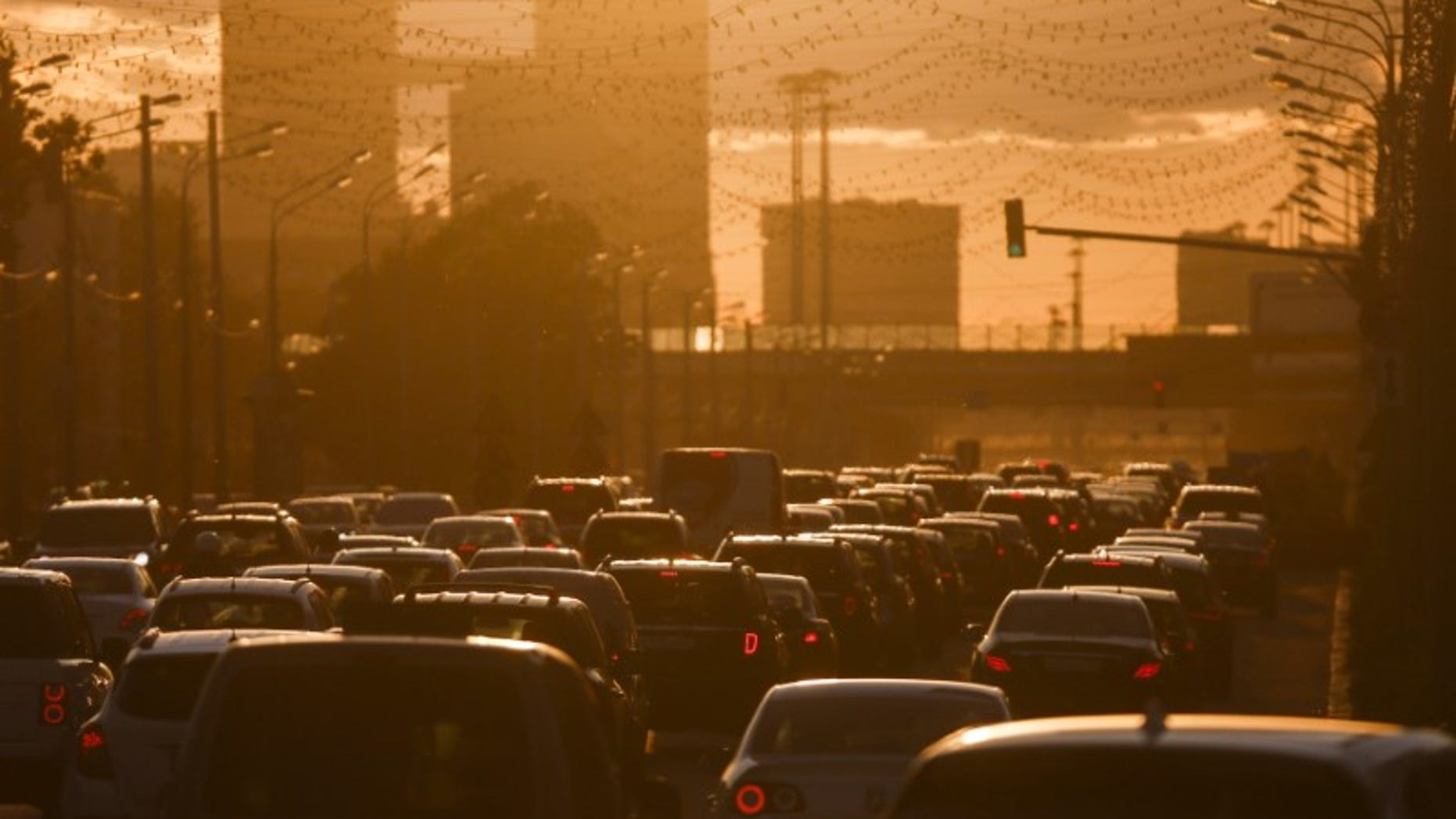 FILE PHOTO: Cars are stuck in traffic jam during sunset in Moscow