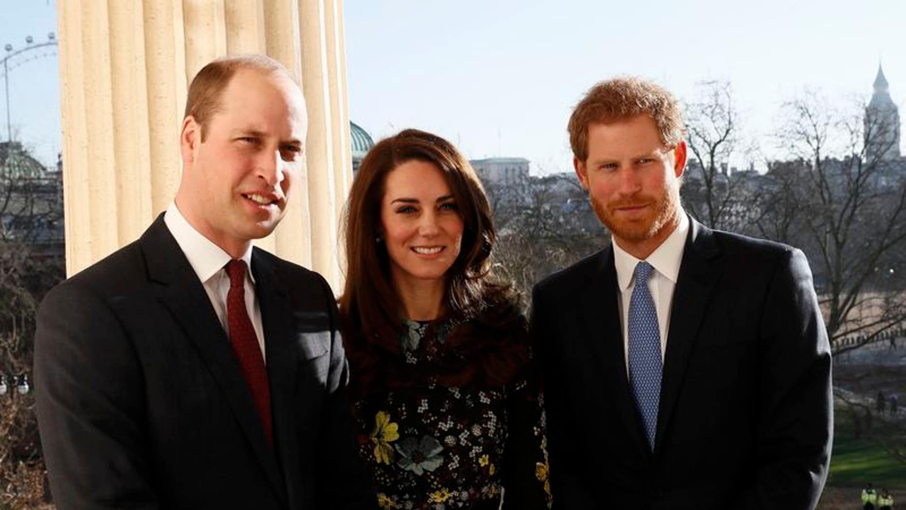 Britain's Prince William, Kate Duchess of Cambridge and Prince Harry pose for p hotograph at the Institute of Contemporary Arts in central London