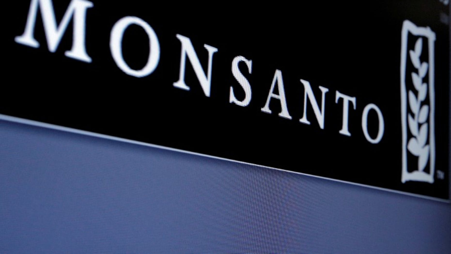Monsanto logo is displayed on a screen where the stock is traded on the floor of the NYSE