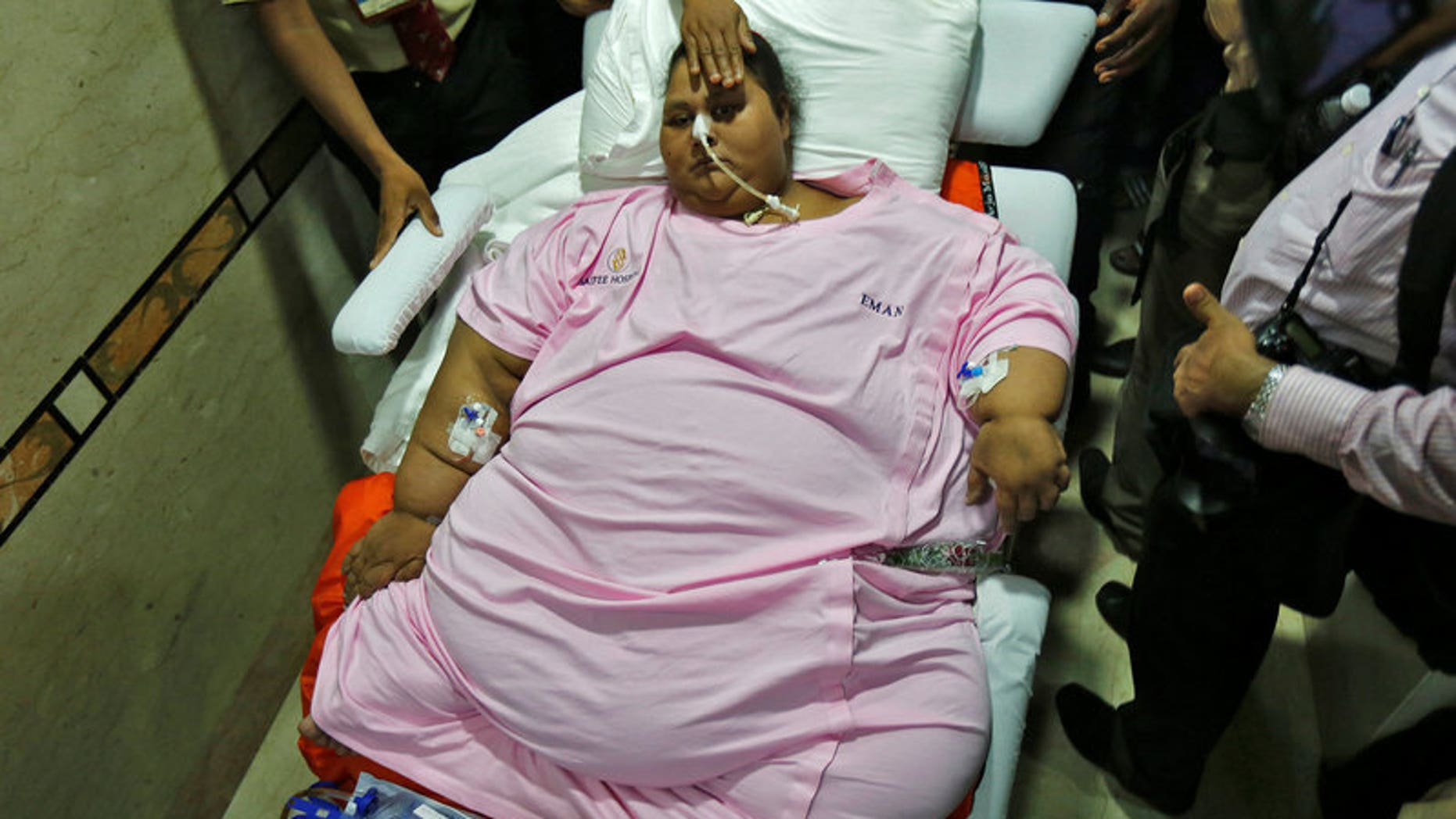 Eman Ahmed, an Egyptian woman who underwent weight loss surgery, is carried on a stretcher as she leaves a hospital in Mumbai