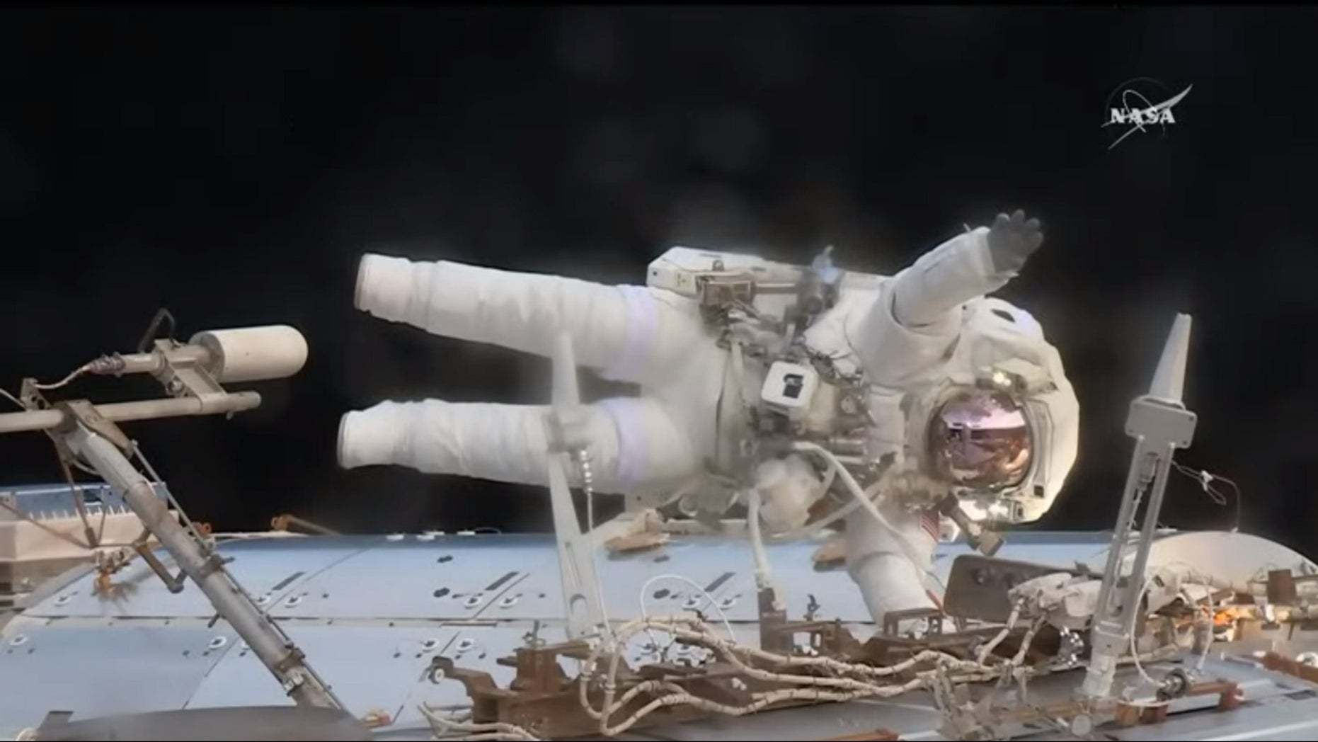 During a spacewalk May 23, NASA astronaut Jack Fischer waved at French astronaut Thomas Pesquet, filming from inside the International Space Station, as Fischer worked to install wireless antennas outside the Destiny lab. The spacewalk's main purpose was to replace a failed data relay box.