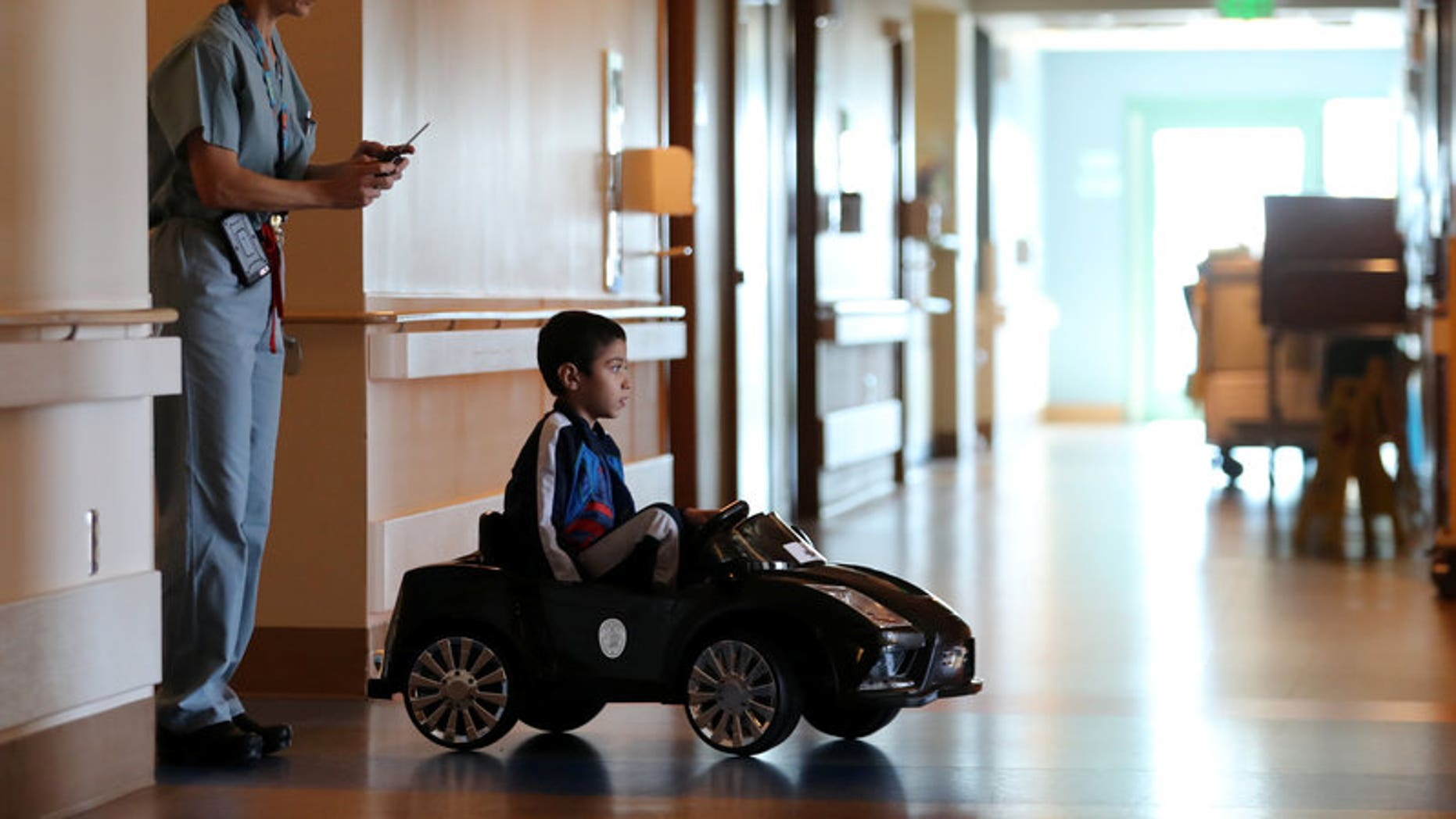 Rady Children's Hospital unveils remote control cars that will transport young patients to the operating room in San Diego