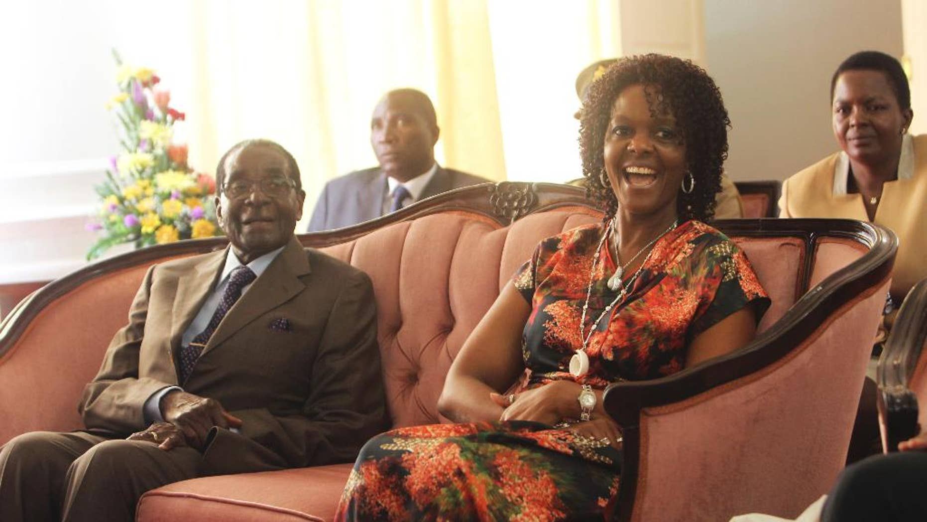 Zimbabwe's President Robert Mugabe and his wife Grace are seen during a birthday party for him in Harare, Feb, 22, 2016.