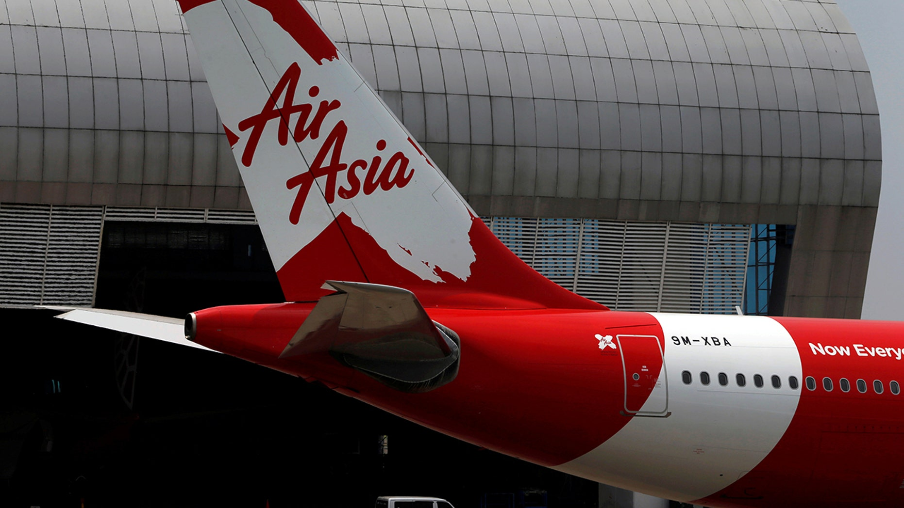 The Malaysia-based airline was accused of deliberately trying to override a passenger clearance system.