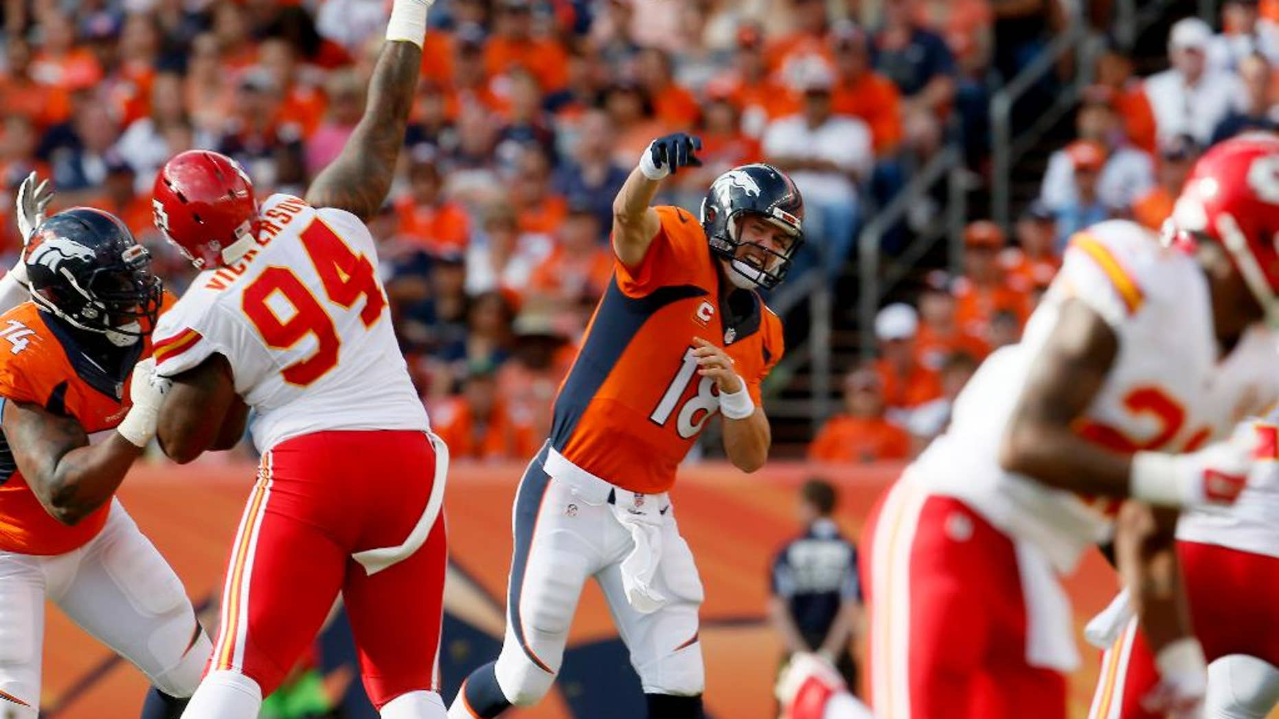 Denver Broncos quarterback Peyton Manning (18) throws against the Kansas City Chiefs during the second half of an NFL football game, Sunday, Sept. 14, 2014, in Denver. (AP Photo/Joe Mahoney)