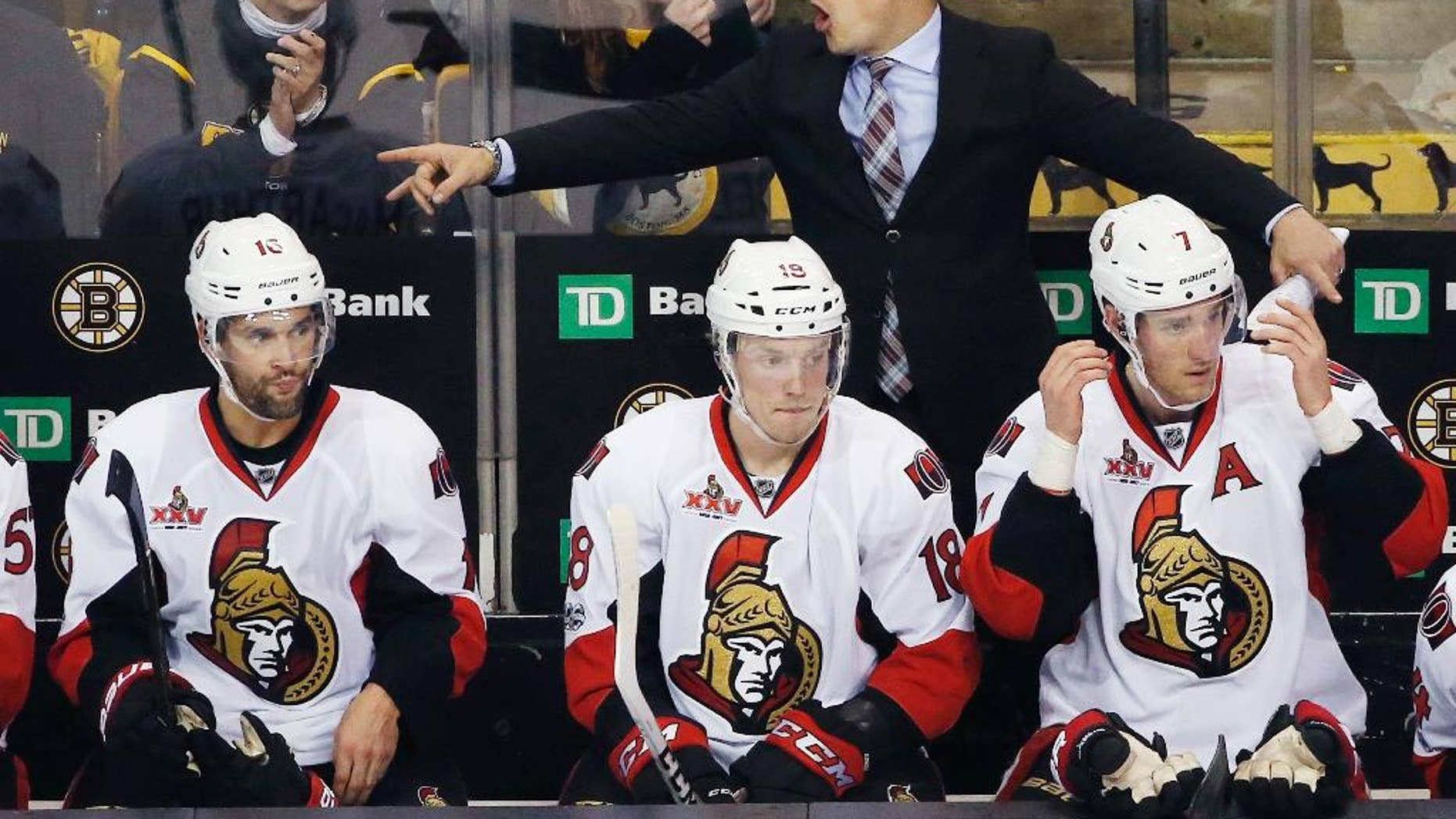 Ottawa Senators head coach Guy Boucher gives instructions during the third period in game six of a first-round NHL hockey Stanley Cup playoff series against the Boston Bruins, Sunday, April 23, 2017, in Boston. The Senators won 3-2 in overtime.(AP Photo/Michael Dwyer)