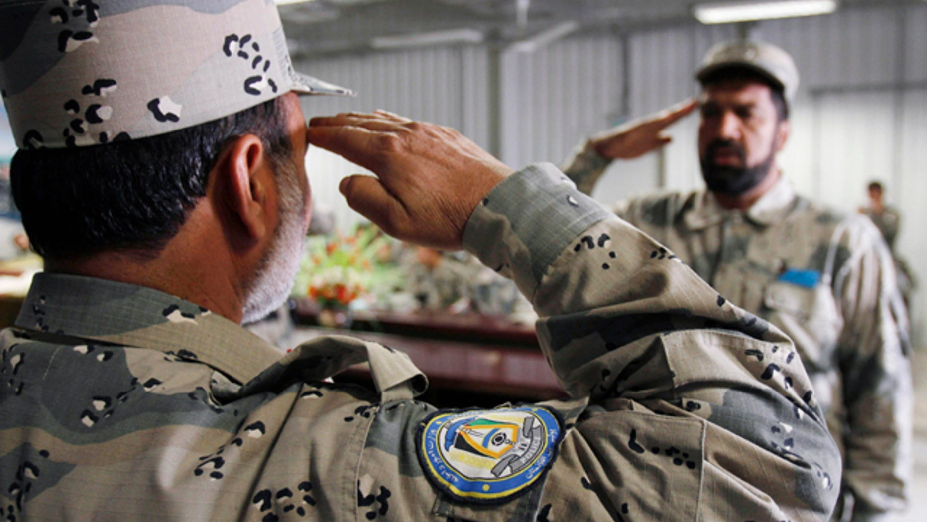 Jan. 31: An Afghan newly graduated border police officer, right, salutes his commander before receiving his certification during a graduation ceremony at the border police headquarter in Jalalabad, Nangarhar province east of Kabul, Afghanistan.