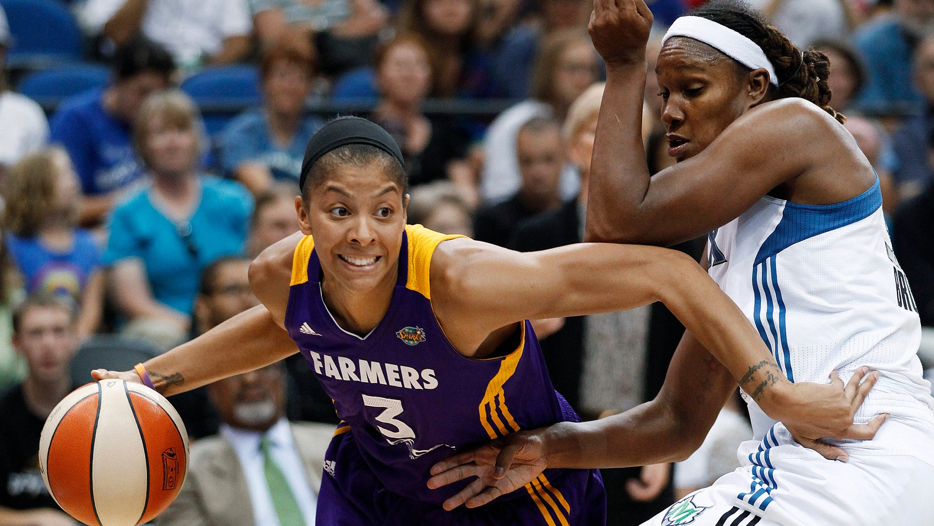 FILE - In this Sept. 4, 2012 file photo, Los Angeles Sparks forward Candace Parker (3) drives past Minnesota Lynx forward Rebekkah Brunson during the second half of a WNBA basketball game in Minneapolis. Parker is ready to resume her pursuit of the only major title to elude her.   (AP Photo/Stacy Bengs, File)