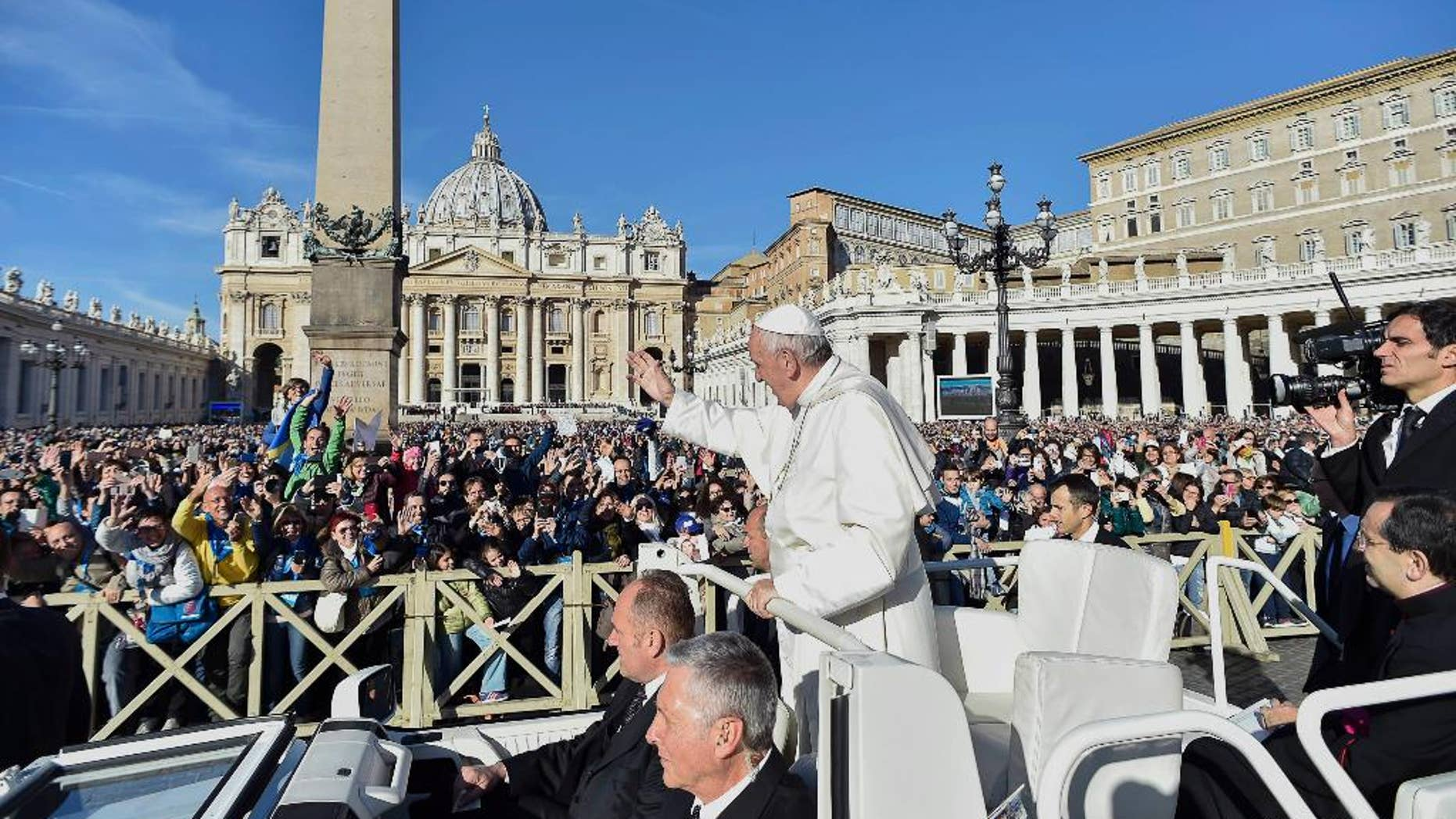 """Pope Francis waves to faithful during a jubilee audience in St. Peter's Square, at the Vatican Saturday, Oct. 22, 2016. (L""""osservatore Romano/Pool Photo via AP)"""