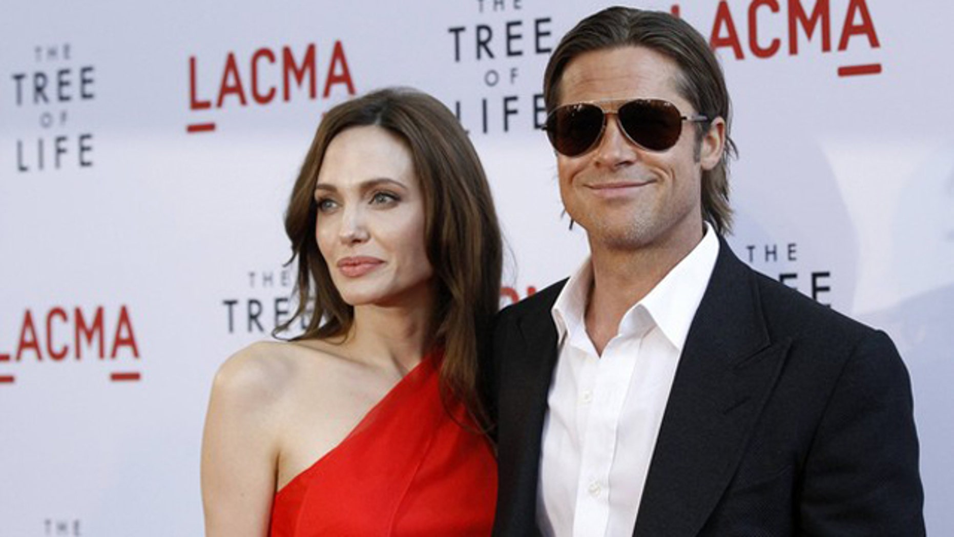 "Brad Pitt and actress Angelina Jolie at the ""Tree of Life"" premiere."