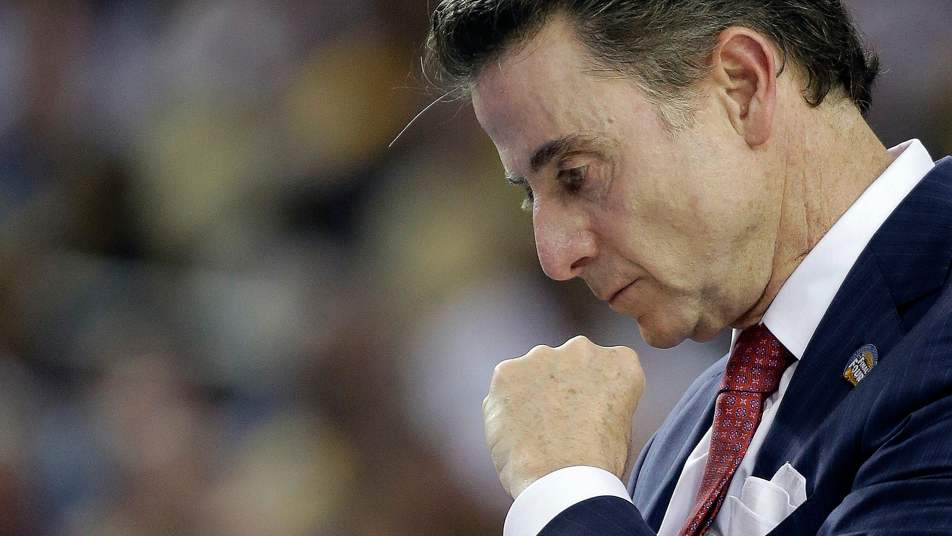 Louisville head coach Rick Pitino walks the court during the first half of a national semifinal at the Final Four of the NCAA college basketball game against Wichita State, Saturday, April 6, 2013, in Atlanta. (AP Photo/David J. Phillip)