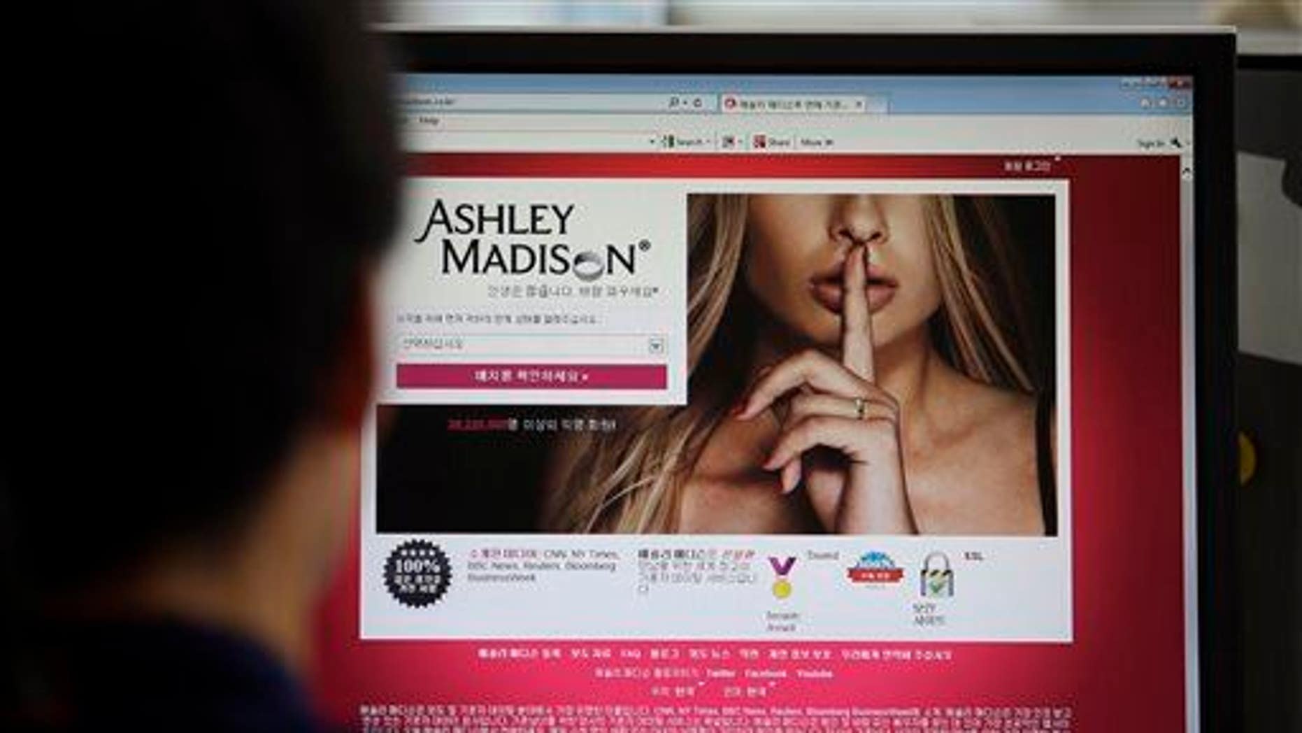 FILE - In this June 10, 2015 photo, Ashley Madison's Korean web site is shown on a computer screen in Seoul, South Korea. (AP Photo/Lee Jin-man, File)
